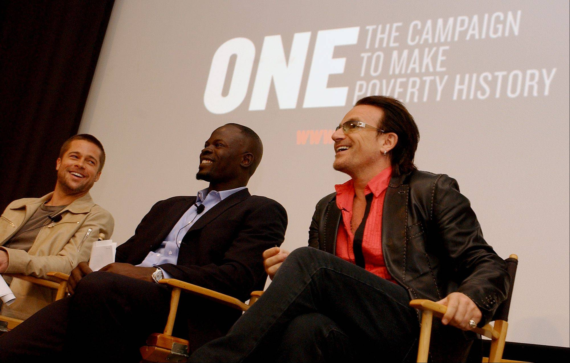 Actors Brad Pitt, left, and Djimon Hounsou, and singer Bono, right, share a light moment during a news conference held to premiere a public service announcement for ONE -- The Campaign to Make Poverty History, Wednesday, April 6, 2005, in Beverly Hills, Calif.