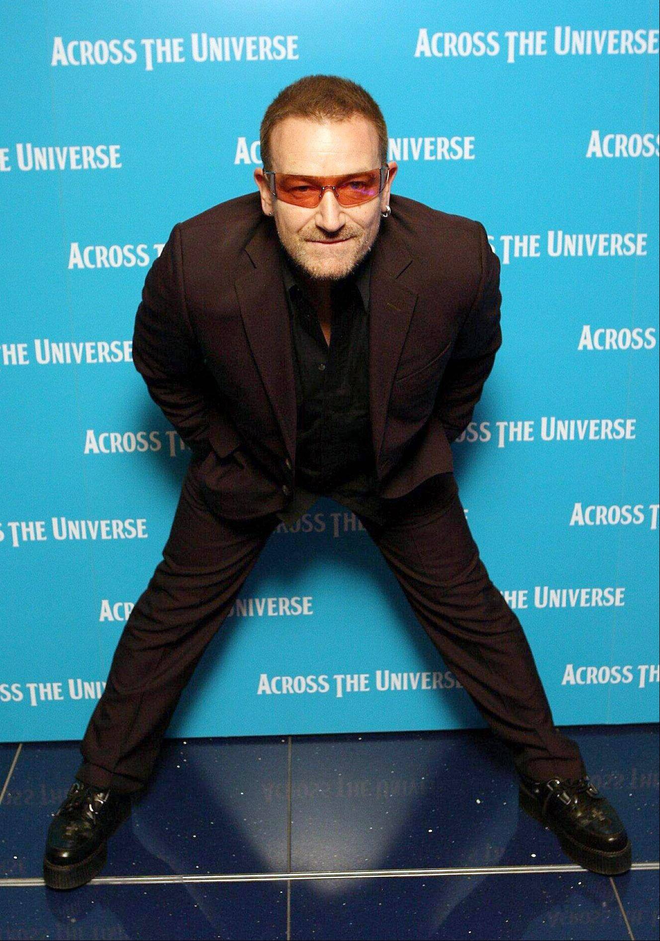 "U2 singer Bono arrives for the premiere of the film Across The Universe at the Apollo cinema, in cental London Wednesday Sept. 26 2007. Bono says he had ""slept uneasily"" since seeing extraordinary photos and TV footage of the violence in Myanmar, and is praying for the country's pro-democracy demonstrators After a month of mostly peaceful demonstrations against Myanmar's military government, security forces opened fire on protesters Wednesday, and witnesses said police beat and detained dozens of Buddhist monks."