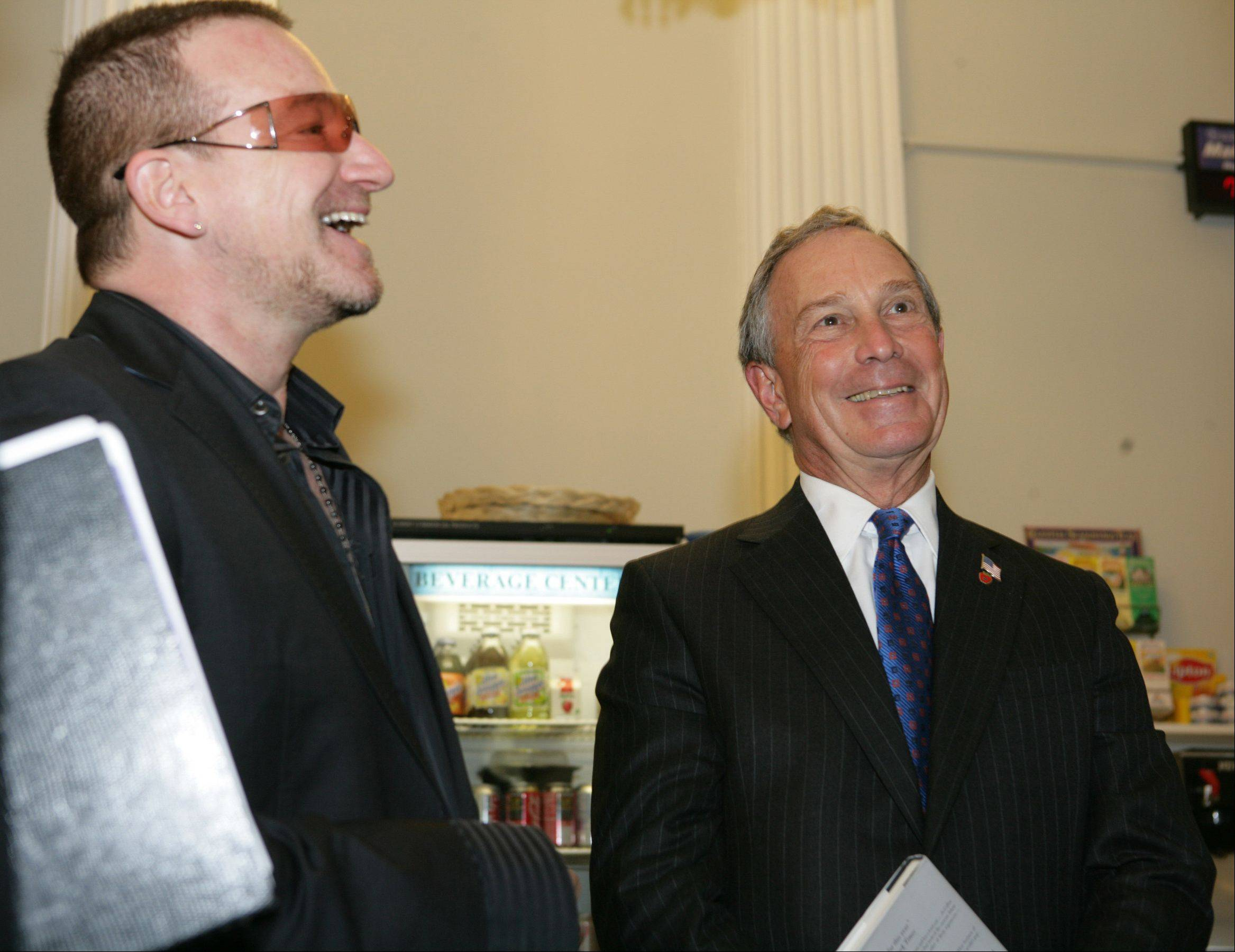 In this photo released by the New York City Mayor's Office, Irish rocker and social activist, Bono, left, stands next to New York City Mayor Michael Bloomberg, Thursday, Nov. 1, 2007 at City Hall in New York. Bono was invited to meet with the mayor, who wanted to know what the singer was working on with his charity projects.