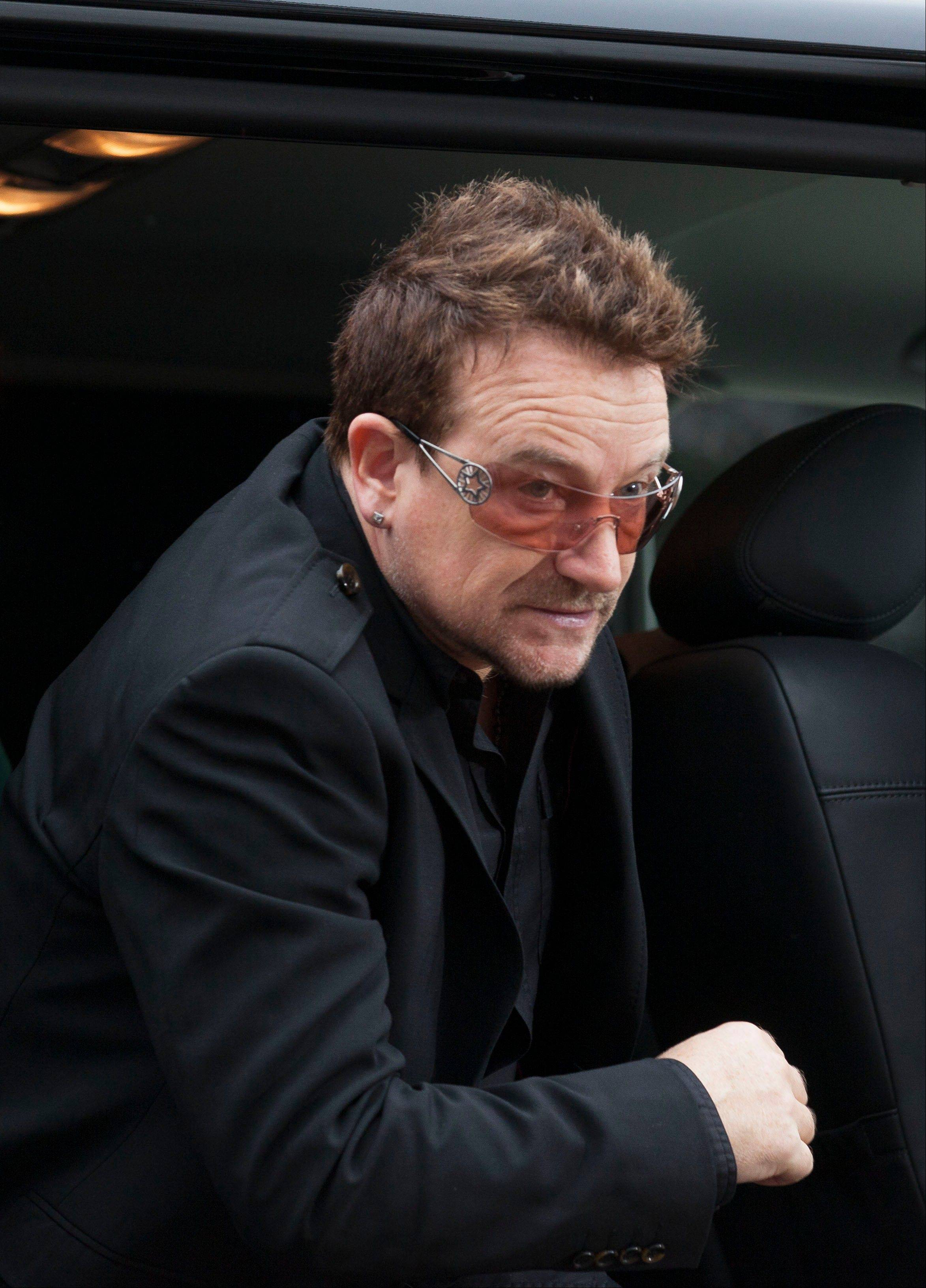 Bono, the Irish rock star and activist arrives for a conference with Myanmar opposition leader Aung San Suu Kyi at the Oslo Forum at the Losby Gods mansion about 13 kilometers (8 miles) east of Oslo, Monday, June 18, 2012. The Oslo Forum is a n international network of armed conflict mediation practitioners.