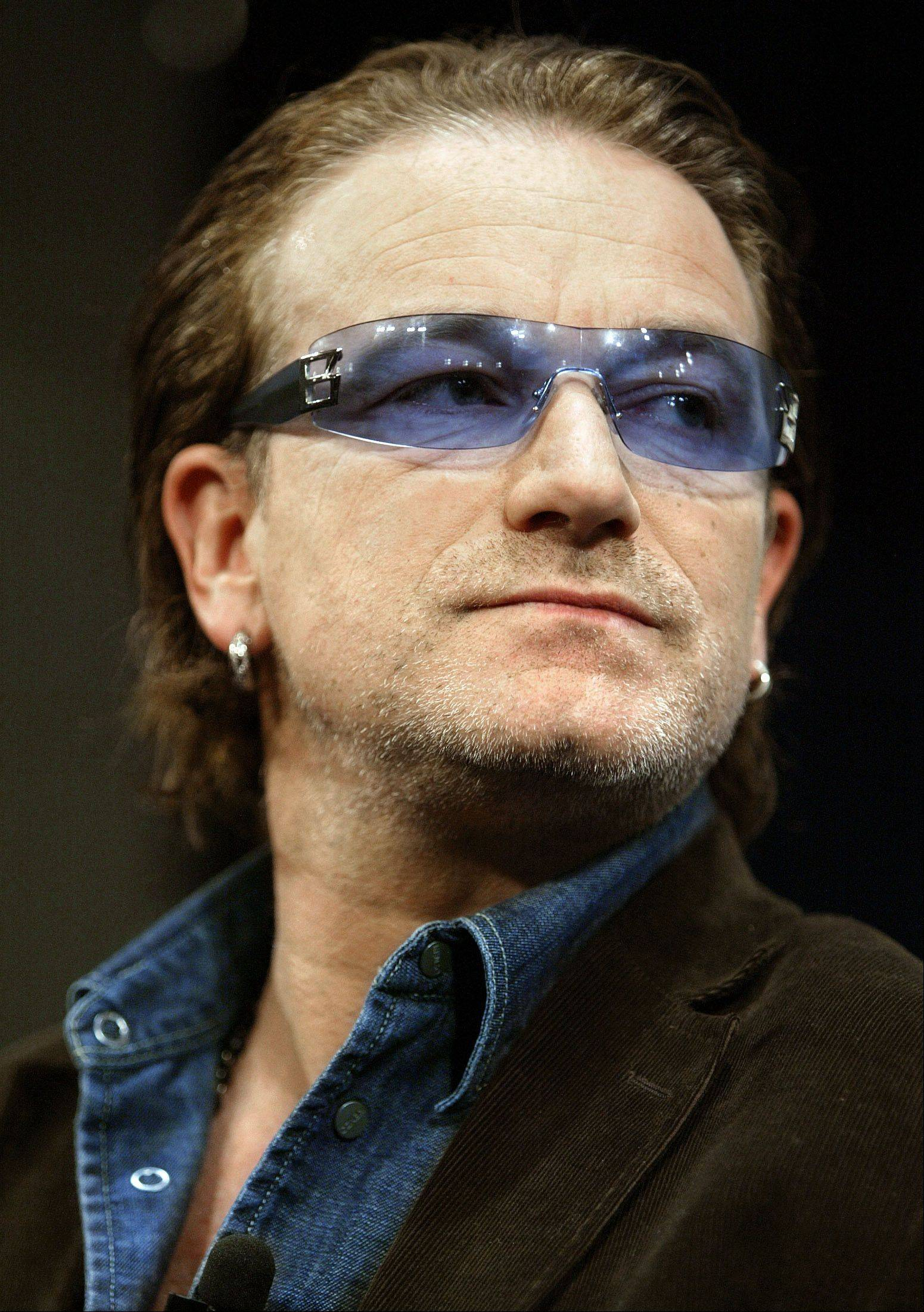 Bono, the Irish rock star and humanitarian, talks about his efforts in the fight against AIDS in Africa, during a webcast interview with the Kaiser Family Foundation in Washington, on Dec. 3, 2003.