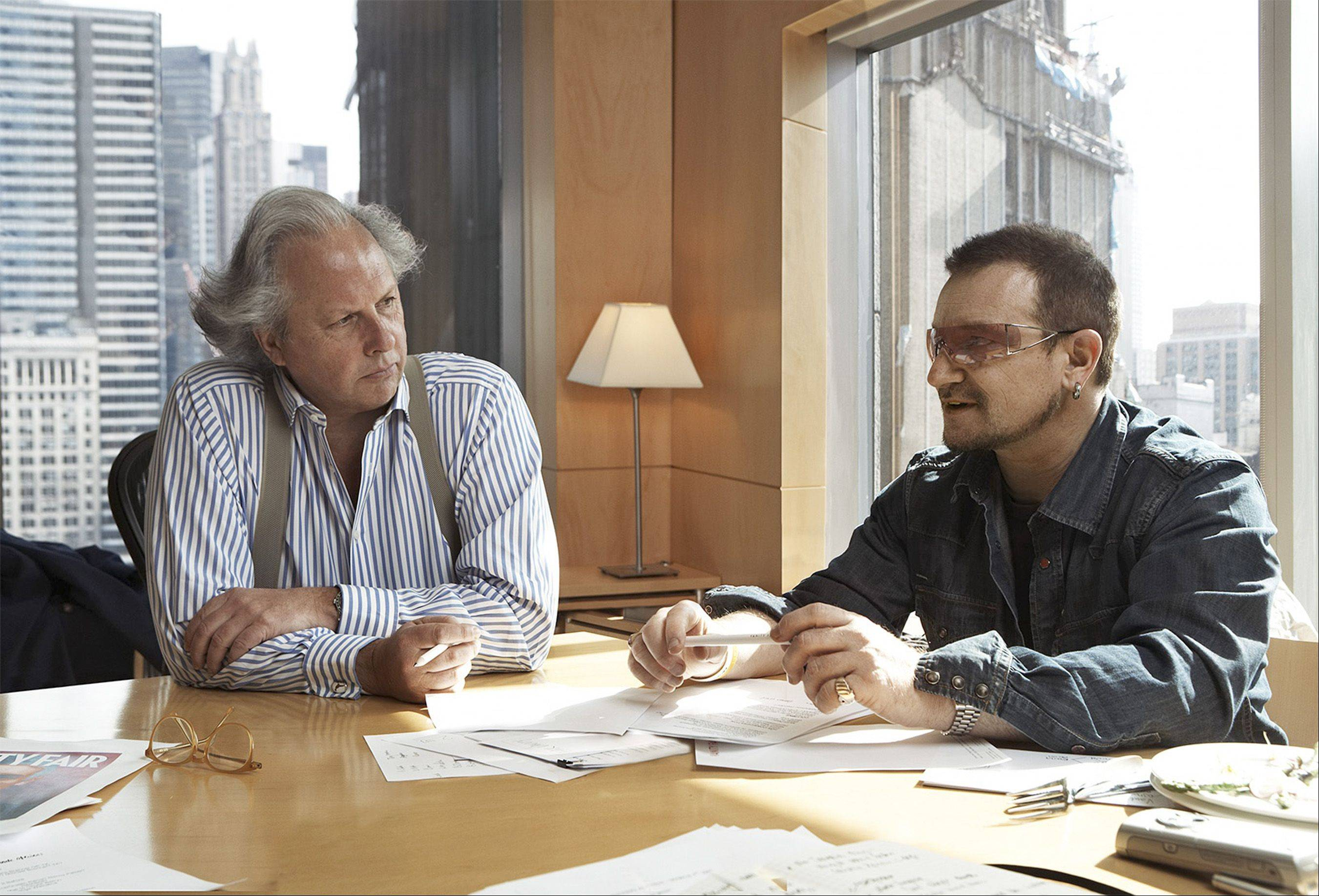 This photo supplied by Vanity Fair shows Vanity Fair Editor Graydon Carter, left, and Rock star Bono discussing the magazine's July African issue which Bono will guest edit, in Carters office on Thursday, March 1, 2007, in New York.