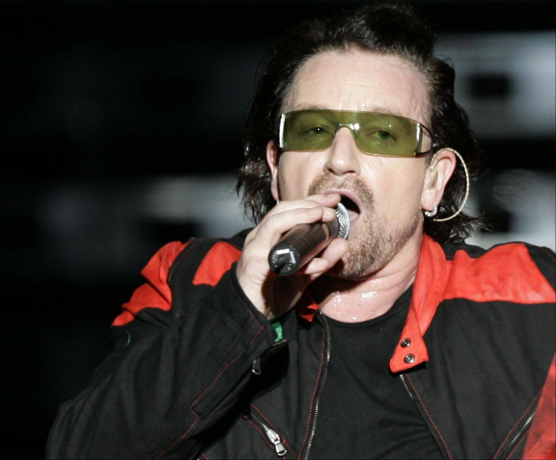 U2's lead singer Bono performs at Morumbi Stadium in Sao Paulo, Brazil Monday, Feb. 20, 2006. Bono, who praised Brazil's anti-AIDS campaign, received a kit containing condoms and information about how to prevent the spread of AIDS during a dinner Wednesday, Feb. 22. 2006, with Culture Minister and pop star Gilberto Gil in Salvador, a coastal city some 1,200 kilometers (750 miles) northeast of Rio de Janeiro, the Health Ministry said.