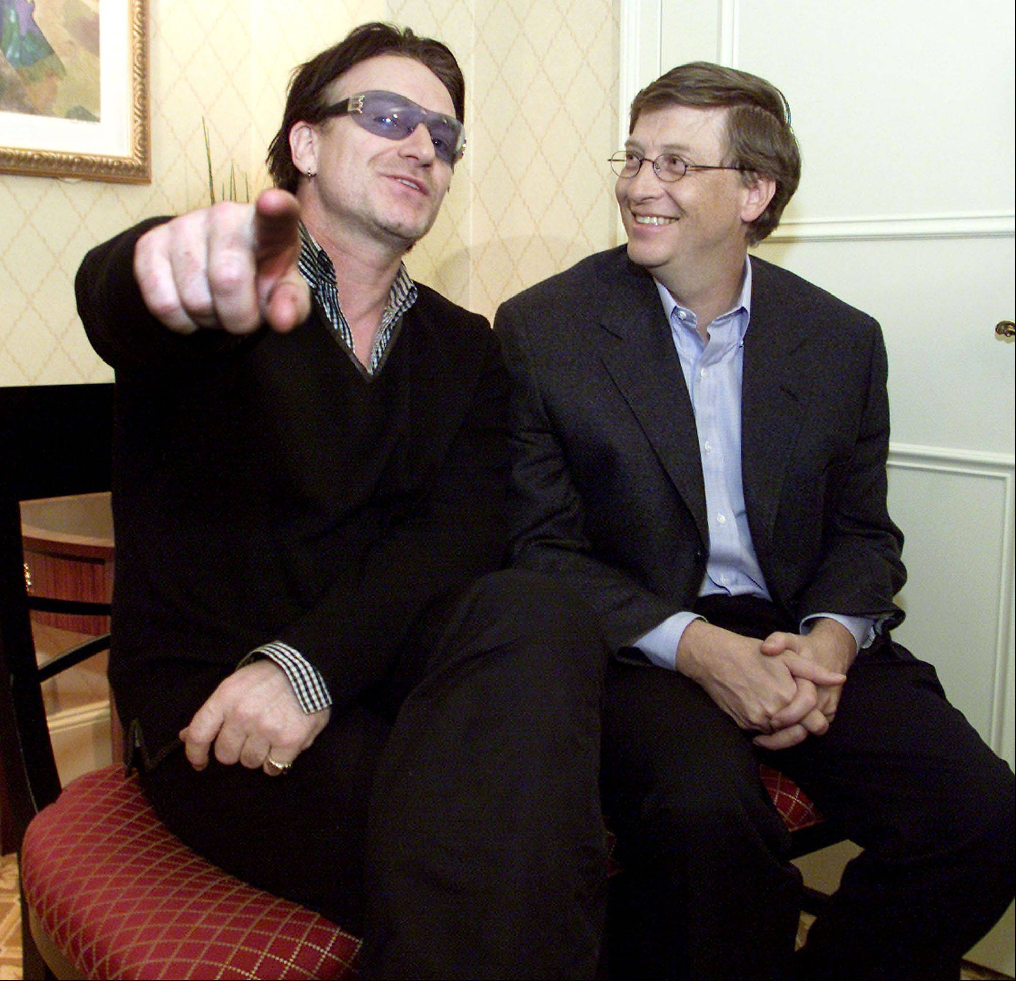 Bono, left, lead singer of the band U2, and Microsoft Corp. Chairman Bill Gates sit together before a news conference at the World Economic Forum in New York, Saturday, Feb. 2, 2002. Bono and Gates both addressed leaders at the World Economic Forum.