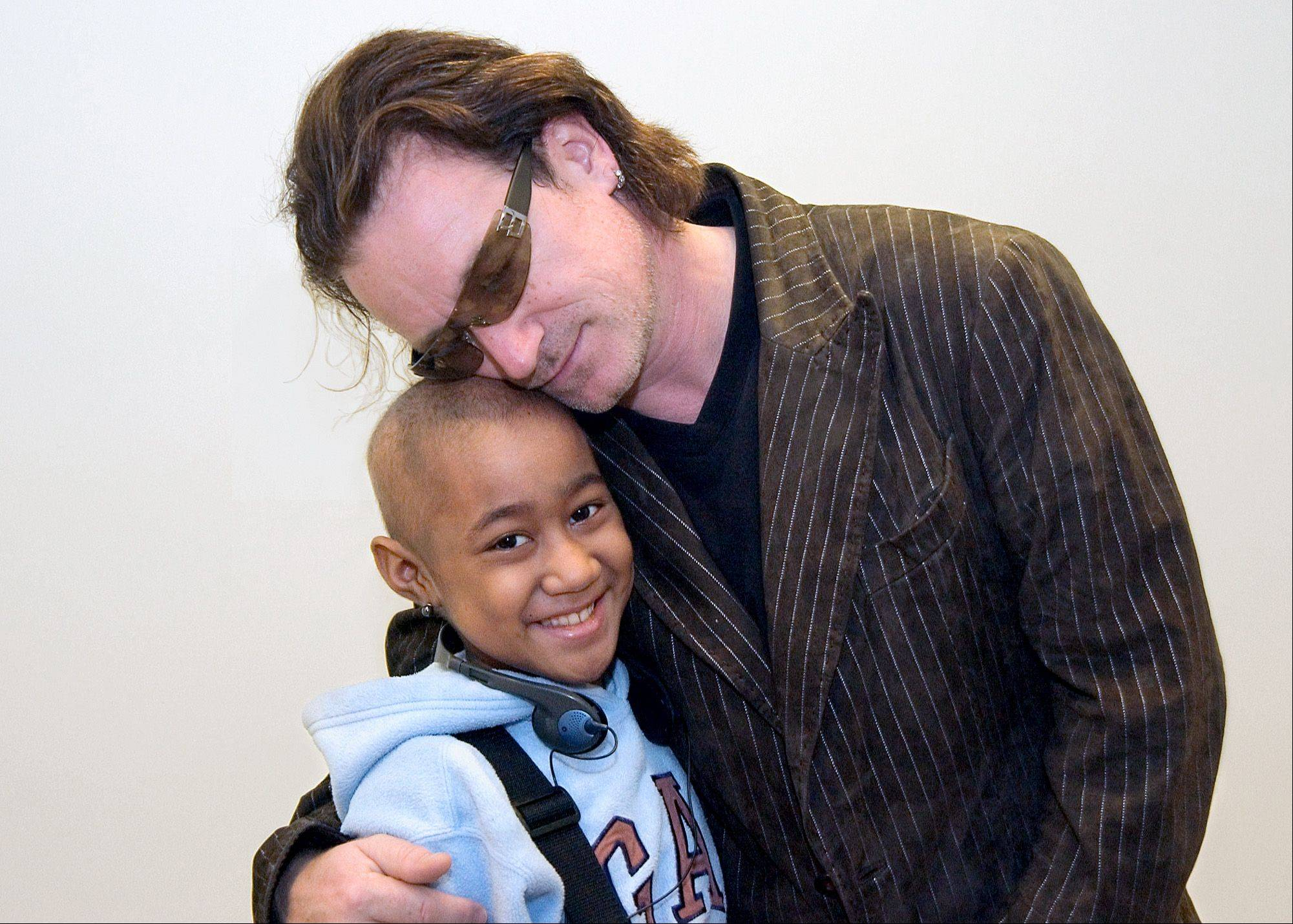 Bono, frontman for U2, greets Luseane Pese, a 10 year-old leukemia patient from Hawaii, at St. Jude Children's Research Hospital Tuesday, Oct. 19, 2004, in Memphis Tenn. Bono was in Tennessee to receive the National Civil Rights Museum's International Freedom Award. The singer/activist, known for his support to increase awareness of the AIDS crisis facing Africa, met with St. Jude researchers who are at work to develop an HIV vaccine.