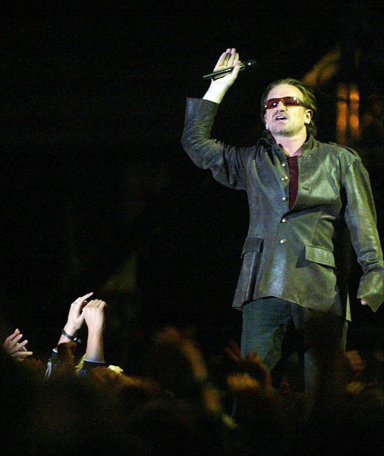 Bono, lead singer from the rock group U2, performs at the Nelson Mandela AIDS Benefit Concert in Cape Town, South Africa, Saturday Nov. 29, 2003. He will be recognized for his humanitarian work at an awards dinner hosted by the family of the Rev. Martin Luther King Jr. Bono will be honored at the 2004 King Center ``Salute to Greatness'' awards dinner on Jan. 17 in Atlanta.