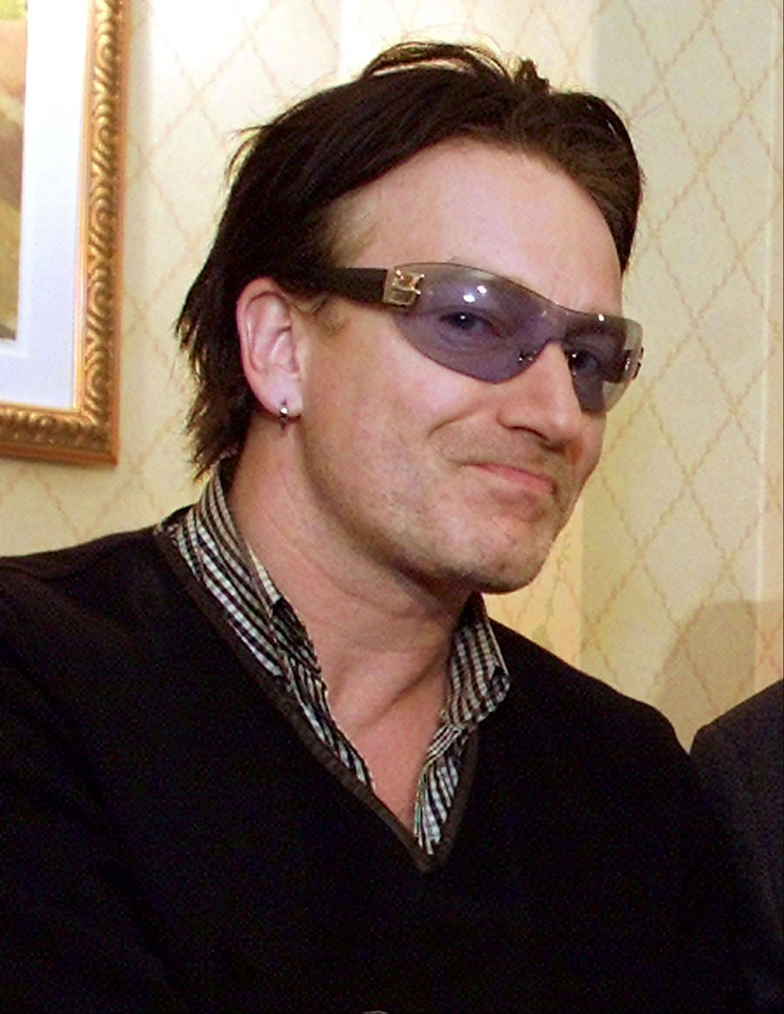 Bono, lead singer of the rock group U2 is seen at a news conference at the World Economic Forum in New York Saturday, Feb. 2, 2002. U.S. Treasury Secretary Paul O'Neill expressed admiration for rock star Bono, saying the U2 singer was well-informed on development issues and genuine in his concern. Bono, whose real name is Paul Hewson, recently addressed the World Economic Forum in New York and has become the main spokesman for Drop the Debt, which campaigns for the canceling developing world debt.