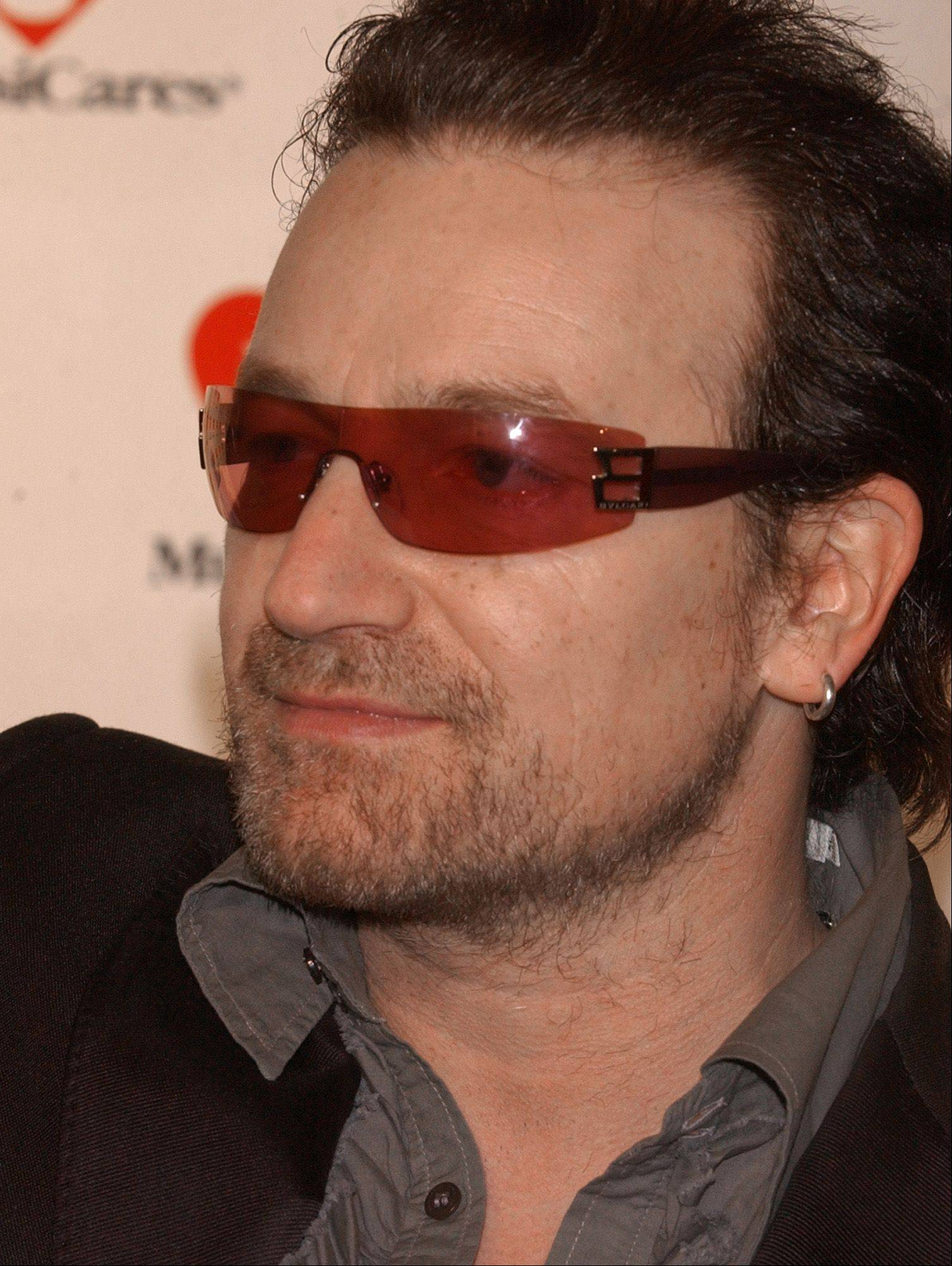 "Bono, lead singer of the Irish rock band U2, arrives at the 2003 MusiCares ""Person of the Year"" 13th annual Gala Friday, Feb. 21, 2003, in New York. Bill Clinton thinks Bono is a leader ""we should follow in the new millennium."" The former president praised the rock star Friday at the celebrity-packed reception."