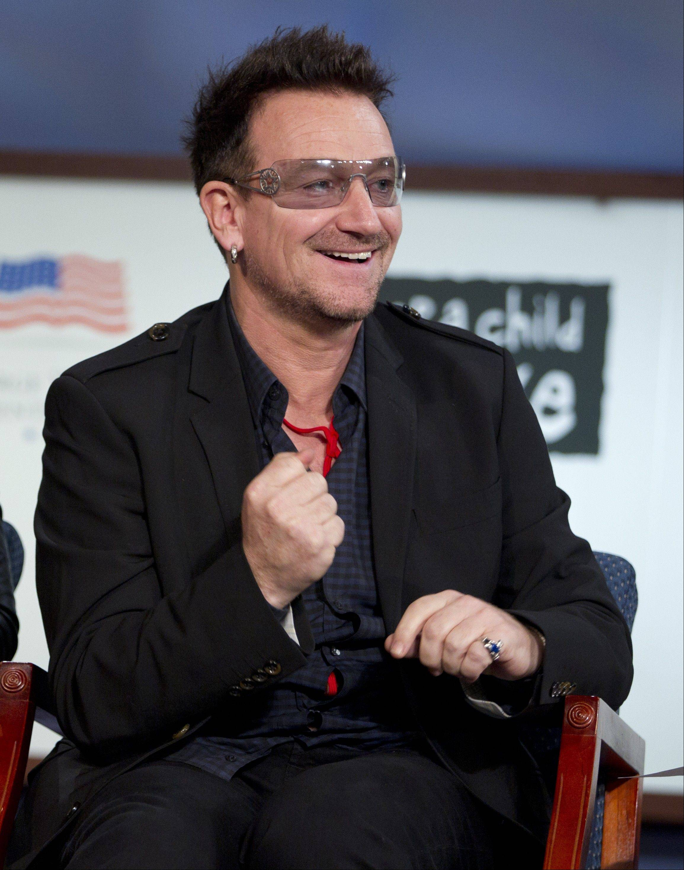 Musician Bono speaks during a panel discussion on World AIDS Day at George Washington University on Thursday, Dec. 1, 2011 in Washington.