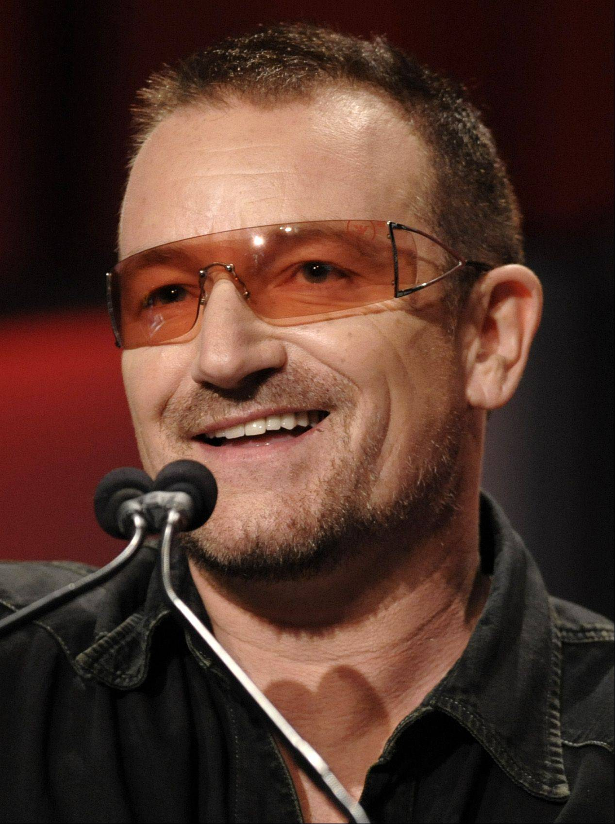 In this Oct. 22, 2008 file photo, Bono addresses the audience at The Women's Conference in Long Beach, Calif.