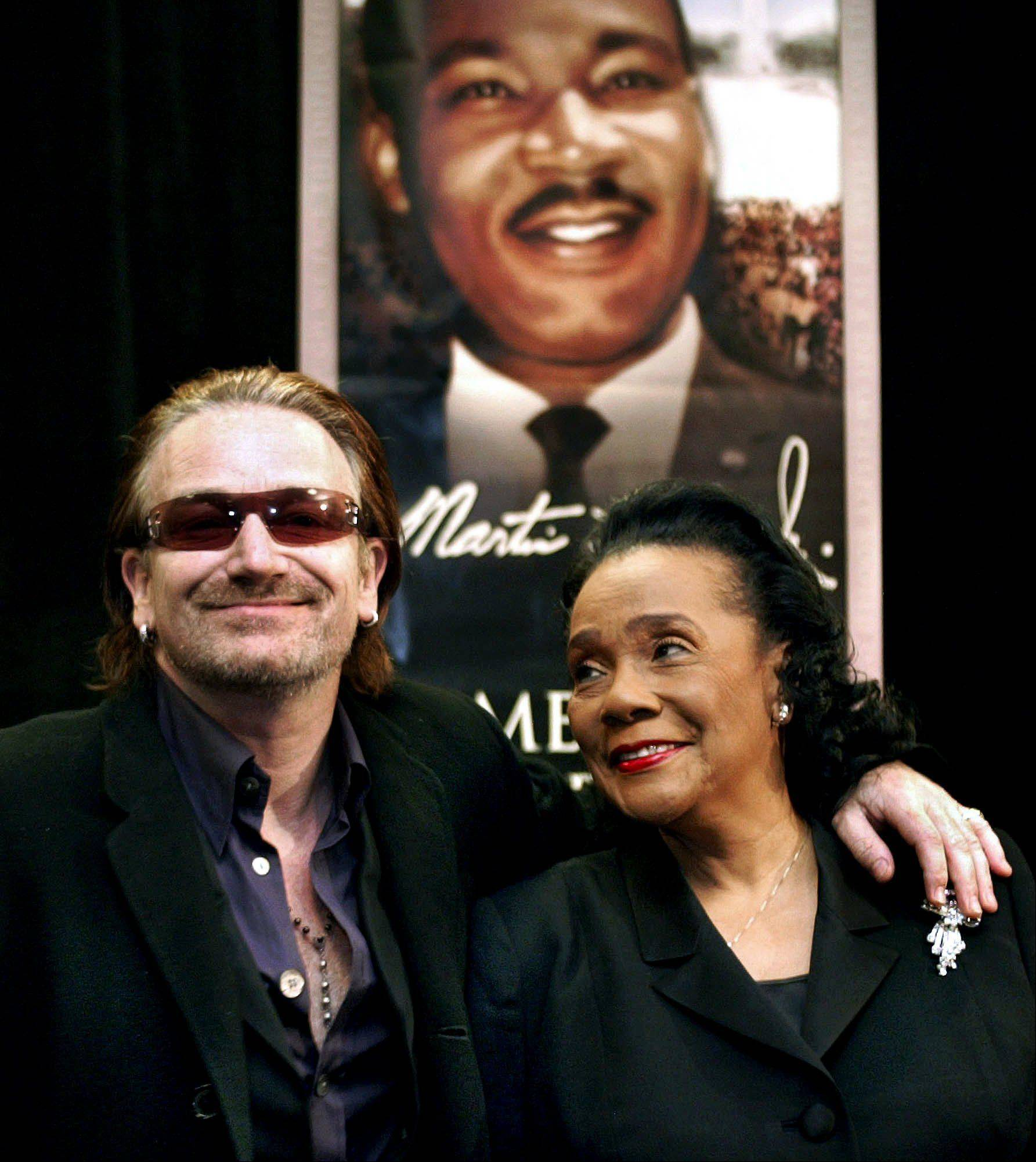 "Bono, left, lead singer of U2, and Coretta Scott King, right, widow of Dr. Martin Luther King Jr., pose at the end of a news conference in Atlanta, Saturday, Jan. 17, 2004. Bono accepted one of The King Center's highest awards later at the annual Salute to Greatness Awards Dinner, part of the annual King Holiday observance. Bono wrote a U2 song about the slain Civil Rights leader, a 1984 hit called ""Pride (In the Name of Love)."""