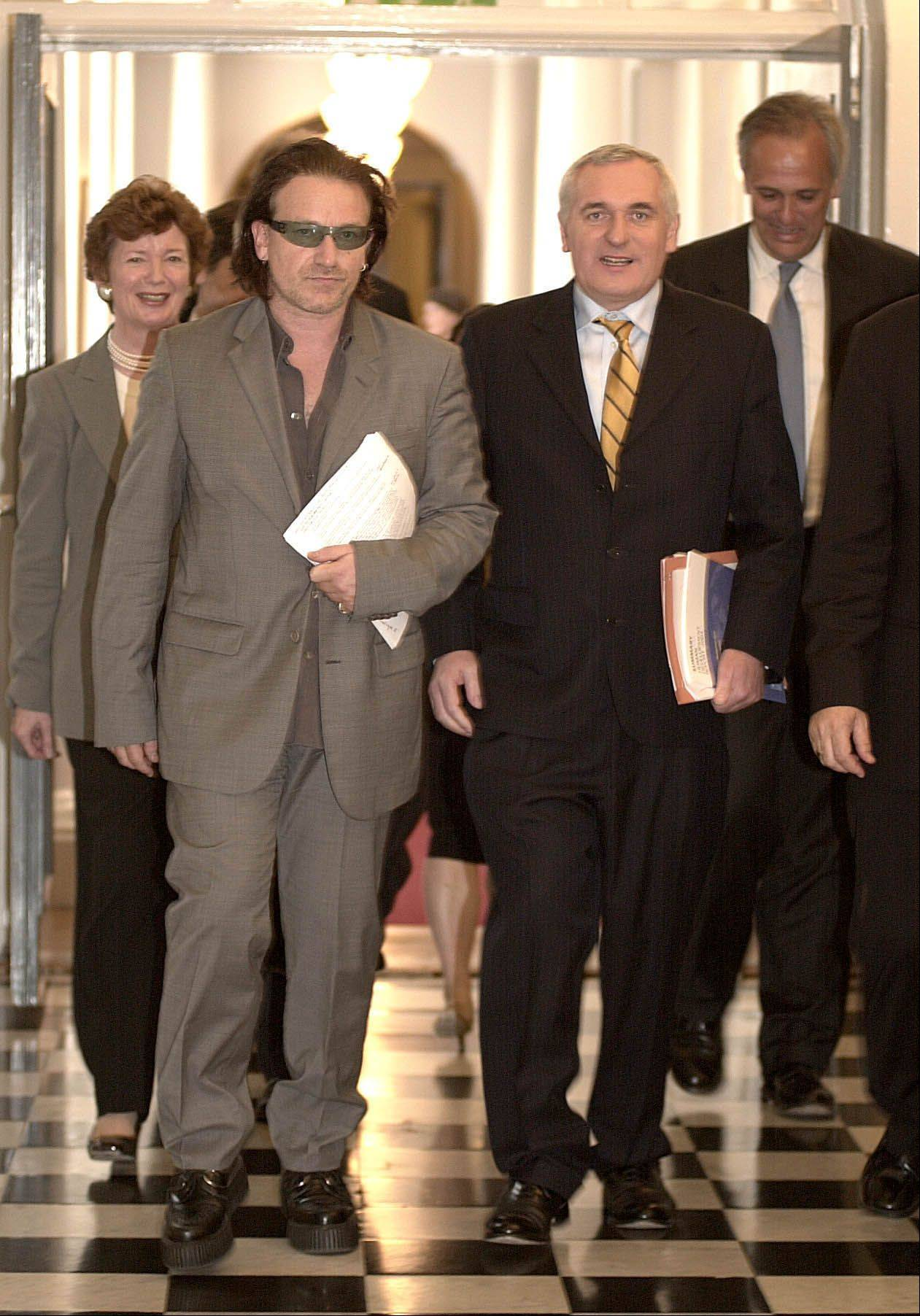 Irish Rock star Bono, arrives with the Irish Prime Minister Bertie Ahern, right, for the Global Launch of the UN Human Development Report 2003 at Government Buildings in Dublin, Ireland, on Tuesday July 8, 2003.
