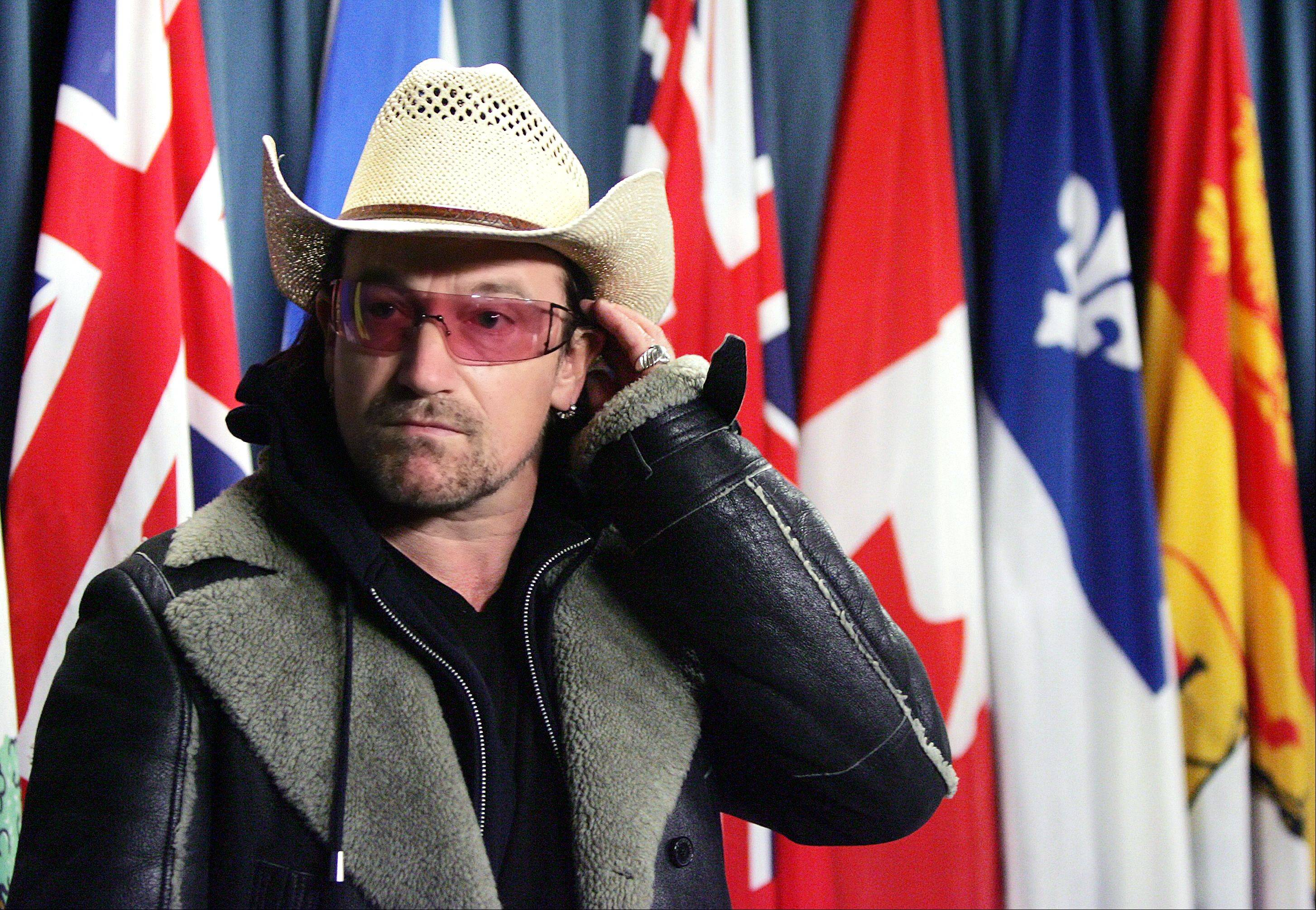 Irish rock star Bono attends a news conference on Parliament Hill in Ottawa Friday, Nov. 25, 2005 prior to U2's sold-out show at the Corel Centre. While in Ottawa Bono met with political leaders and addressed world poverty.