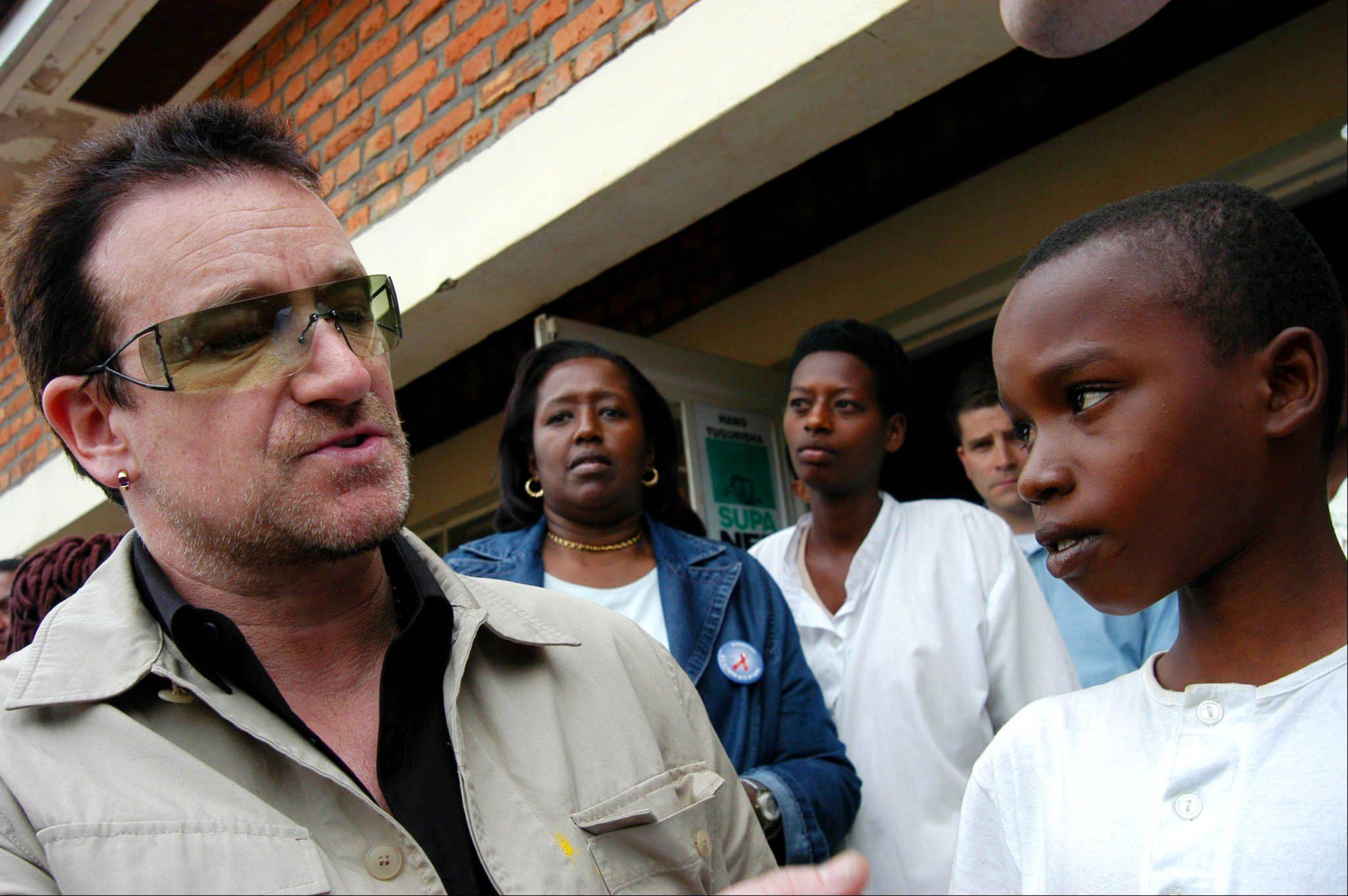 This is a Thursday May 18, 2006 file photo of Irish rock star Bono meets an unidentified boy suffering from hearth problems at a health center in Mayange, Rwanda. Bono was touring some African nations to support the Global Fund to fight AIDS, malaria and tuberculosis. A nearly $22 billion development fund backed by celebrities and hailed as an alternative to the bureaucracy of the United Nations sees as much as one-third to two-thirds of some grants eaten up by corruption, The Associated Press has learned.