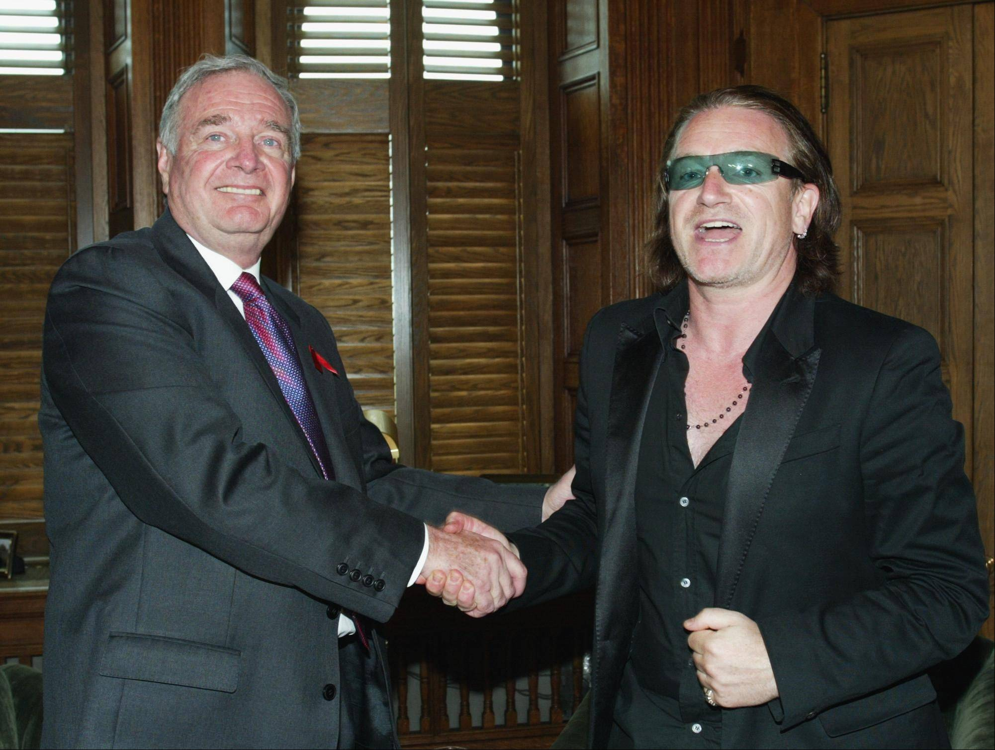 Canadian Prime Minister Paul Martin, left, shakes hands with U2 lead singer Bono on Parliament Hill in Ottawa Wednesday, May 12, 2004.