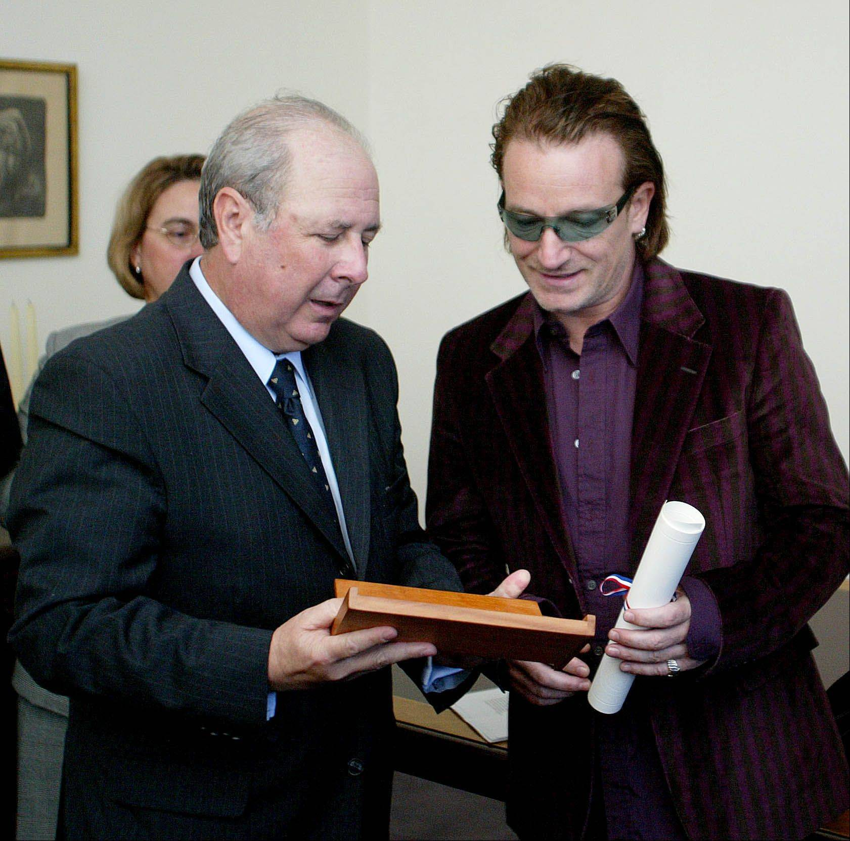 Irish Rock star and frontman for U2, Bono, right, accepts the Pablo Neruda Medal of Honor from the Chilean Ambassador to Ireland Alberto Yoacham at the embassy in Dublin, Thursday Sept. 23, 2004. The award is presented to the 100 most outstanding figures in public life for their contribution to arts and culture all over the world.