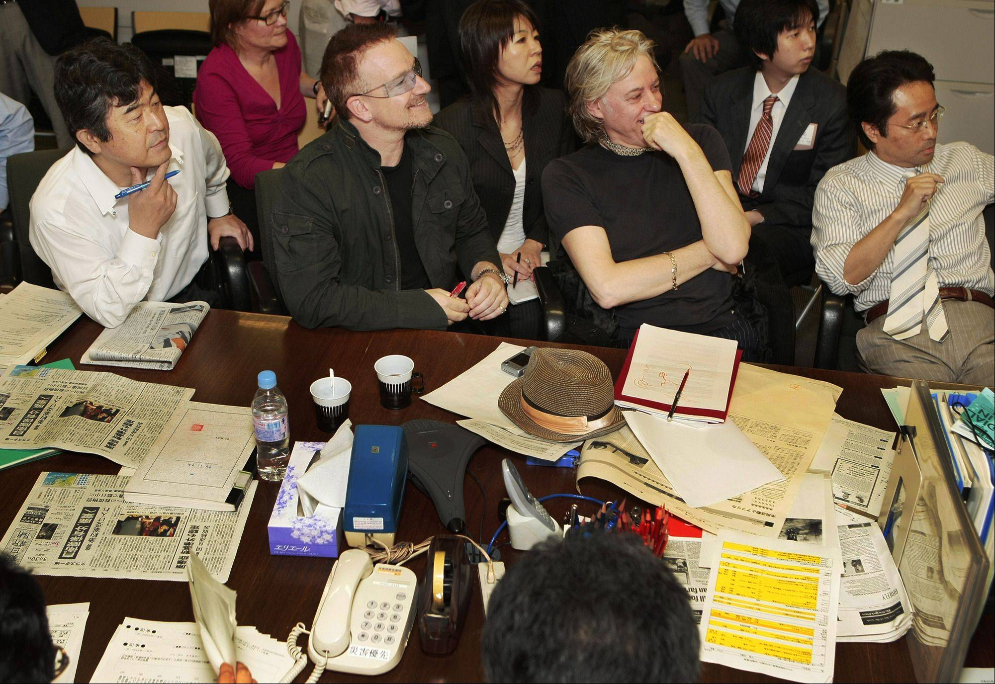 U2 frontman Bono, second left, Bob Geldof, second right, Asahi Shimbun general editor Masahiko Yokoi, left, and deputy managing editor Yoichi Nishimura watch a screen during their editorial conference at the Asahi Shimbun Tokyo headquarters, Friday, May 30, 2008. The ubiquitous U2 frontman and fellow musician Geldof were guest editors at Japan's second-largest newspaper, the Asahi, on Friday to help organize a special edition on anti-poverty activists' favorite subject: Africa.