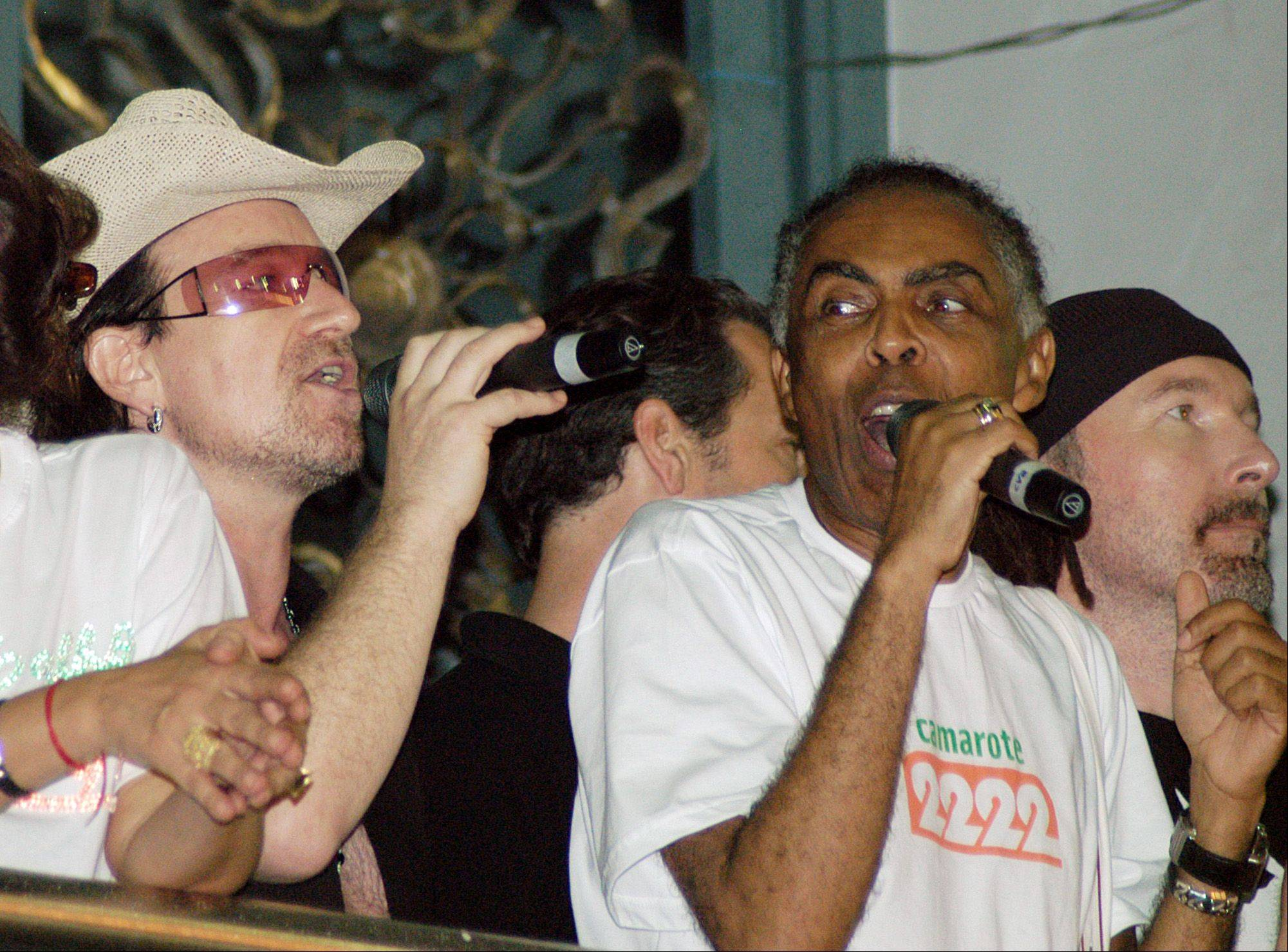 U2's Bono, left, performs with Brazilian Culture Minister and pop star Gilberto Gil, right, on Thursday, Feb. 23, 2006. The singer is attending Salvador, Brazil's Carnival as a guest of the minister. At far right is U2's The Edge.