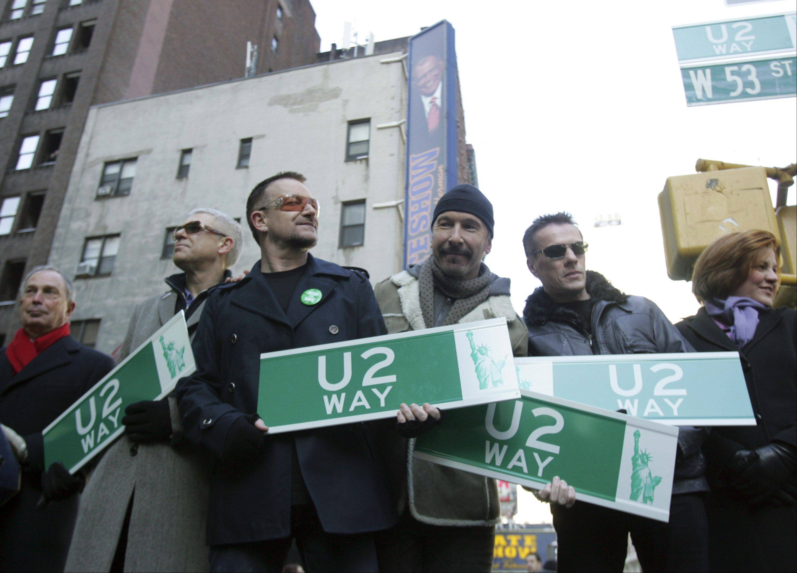 New York Mayor Michael Bloomberg, left, and New York Council Speaker Christine Quin, right, are joined by members of the band U2, from second left, Adam Clayton, Bono, The Edge and Larry Mullen during a ceremony, Tuesday, March 3, 2009 in New York. A section of Manhattan's West 53rd Street was temporarily renamed after the veteran Irish rockers on Tuesday.