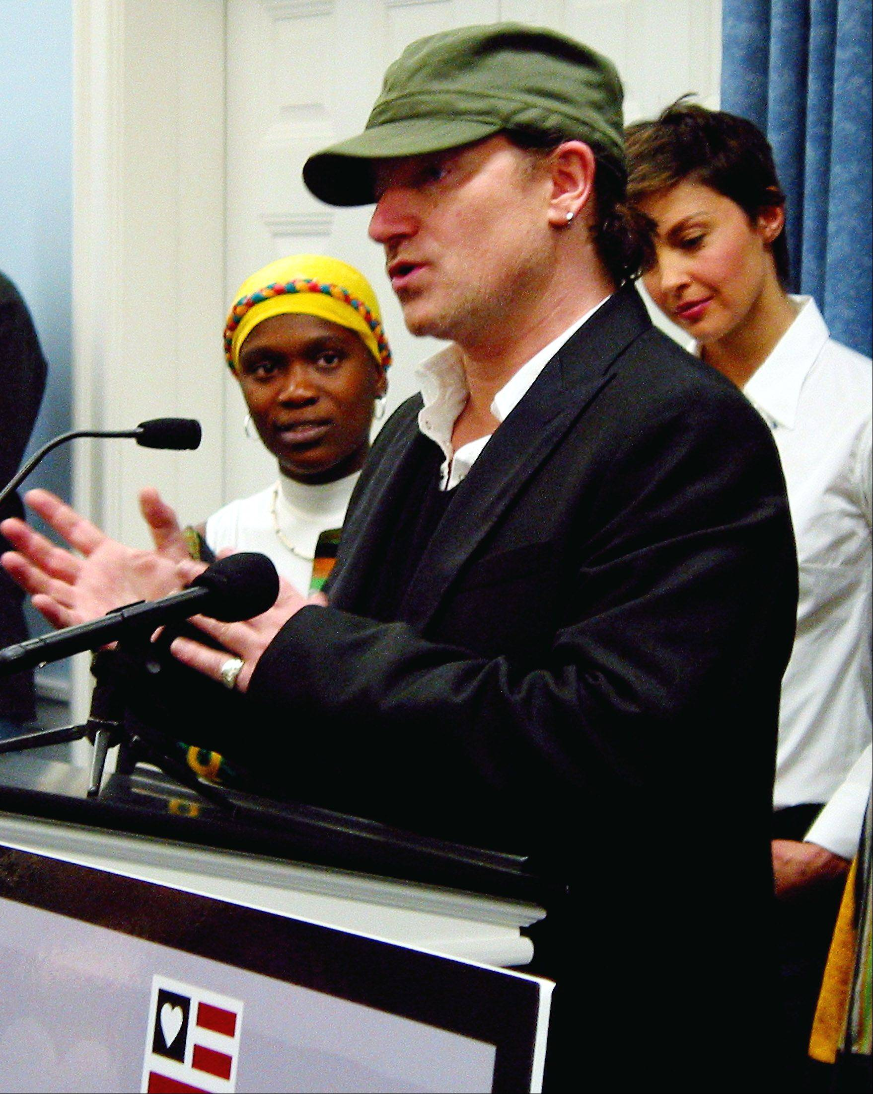 Bono, center, visits Wheaton College to discuss Africa's struggle with AIDS in 2002. Ashley Judd, on his right.