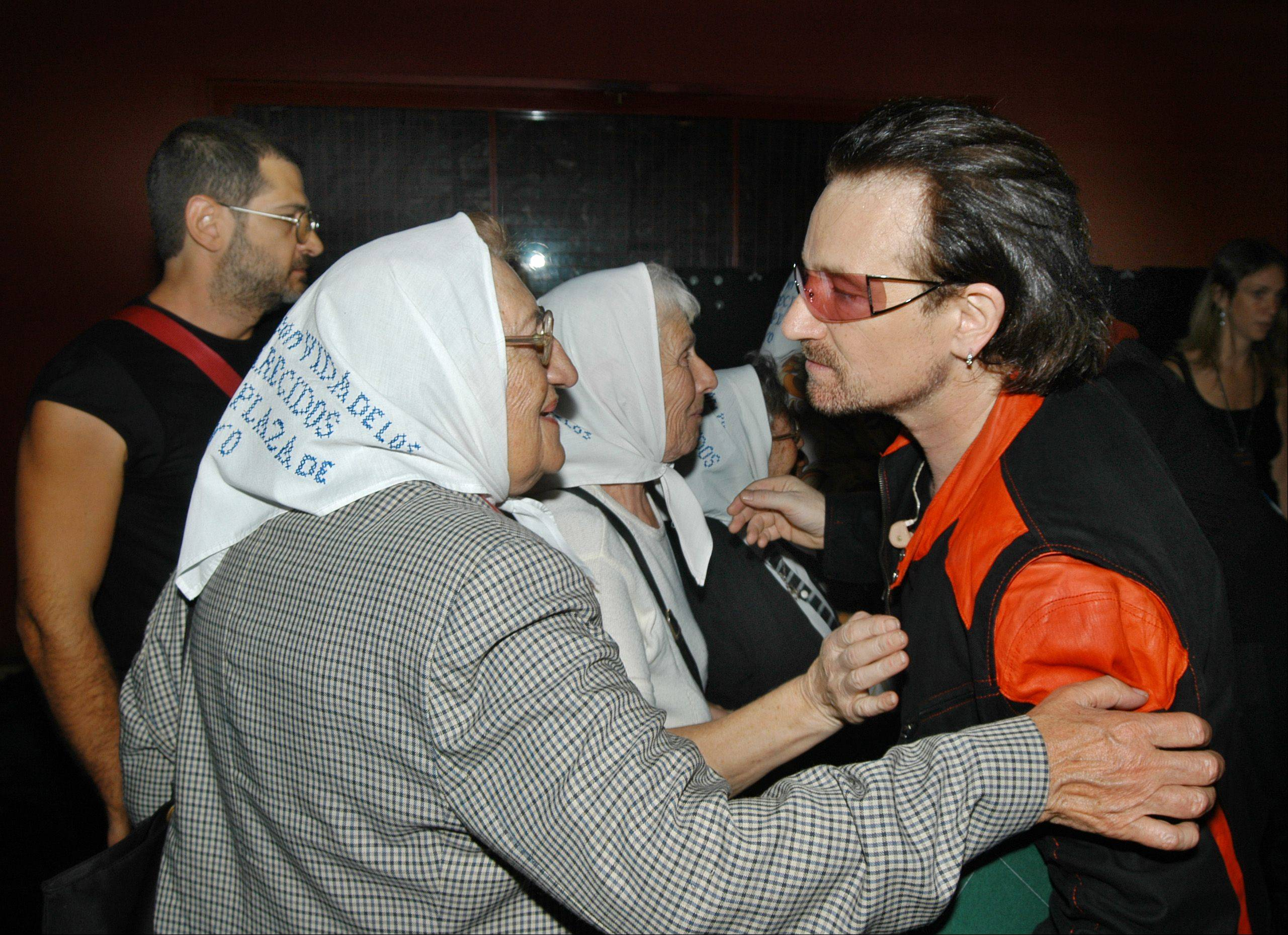 Bono greets some of the Mothers of the Plaza de Mayo at U2's final concert in Buenos Aires, Argentina, Thursday, March 2, 2006, honoring the human rights group that arose during Argentina's past dictatorship. Five of the famously handkerchiefed Mothers, whose children disappeared during a state crackdown on dissent during the 1976-83 junta, attend the last two shows.