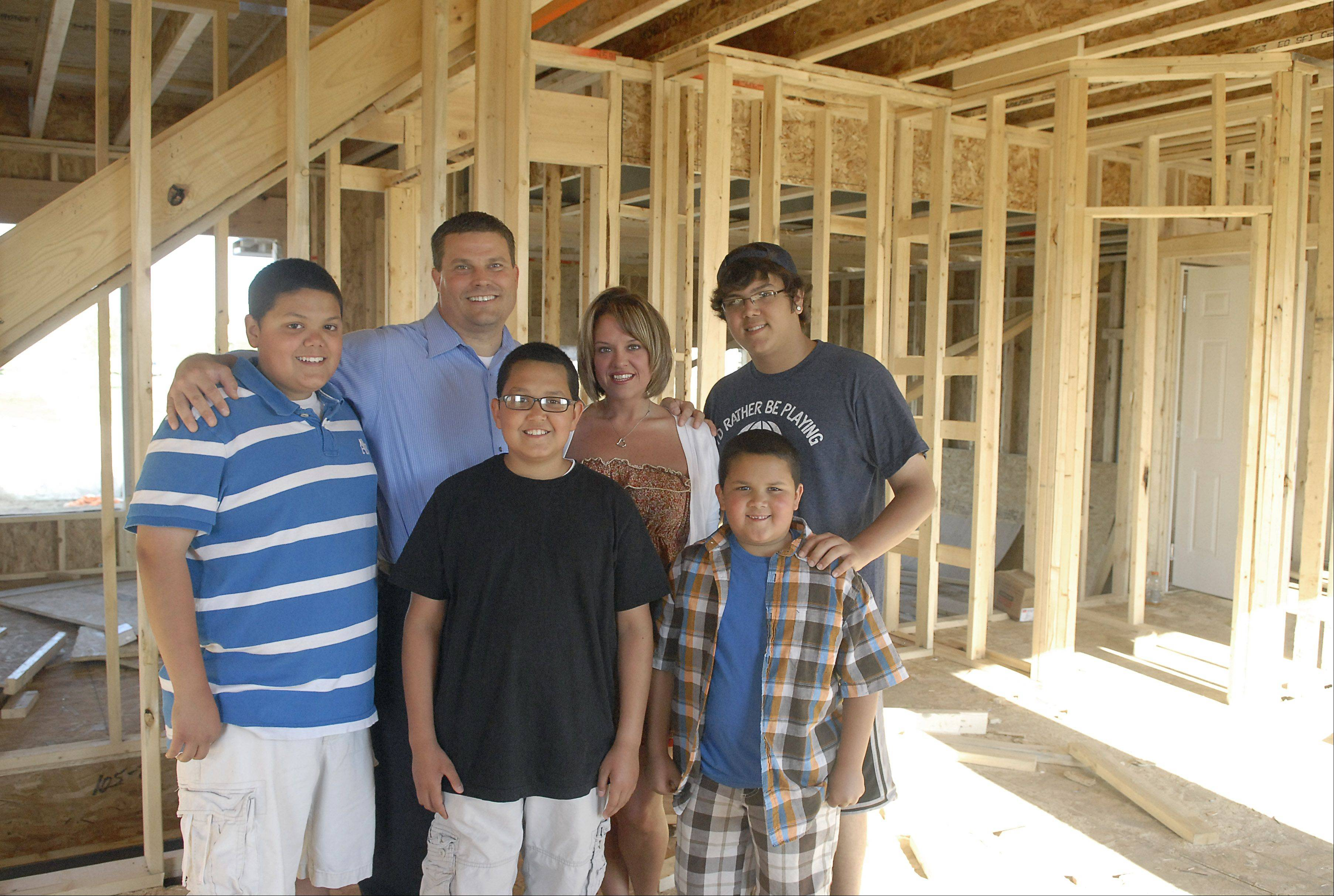 Michelle Lopez, her four sons and boyfriend, Peter Truschke, are having a home built in the Winchester Glen subdivision in Carpentersville. They expect it to be completed by August. Lopez's sons are, left to right, Justin, 14, Stephen, 11, Matthew, 7, and Erick, 17.