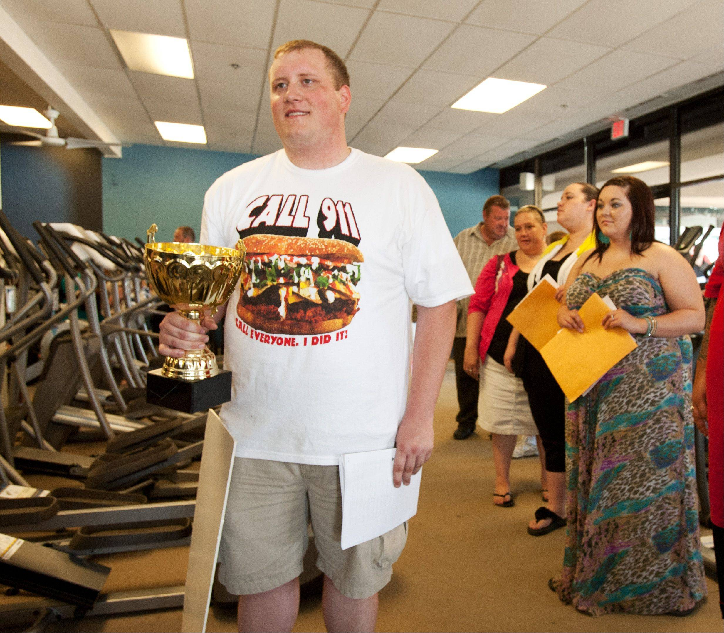 "Former professional eater Jacob Larry of Chicago was among hundreds who filed through a casting call Saturday in Downers Grove for NBC's ""The Biggest Loser."" Larry wore a T-shirt he won by eating a 5-pound hamburger in 12 minutes and brought with him a trophy for eating 17 hot dogs in five minutes."