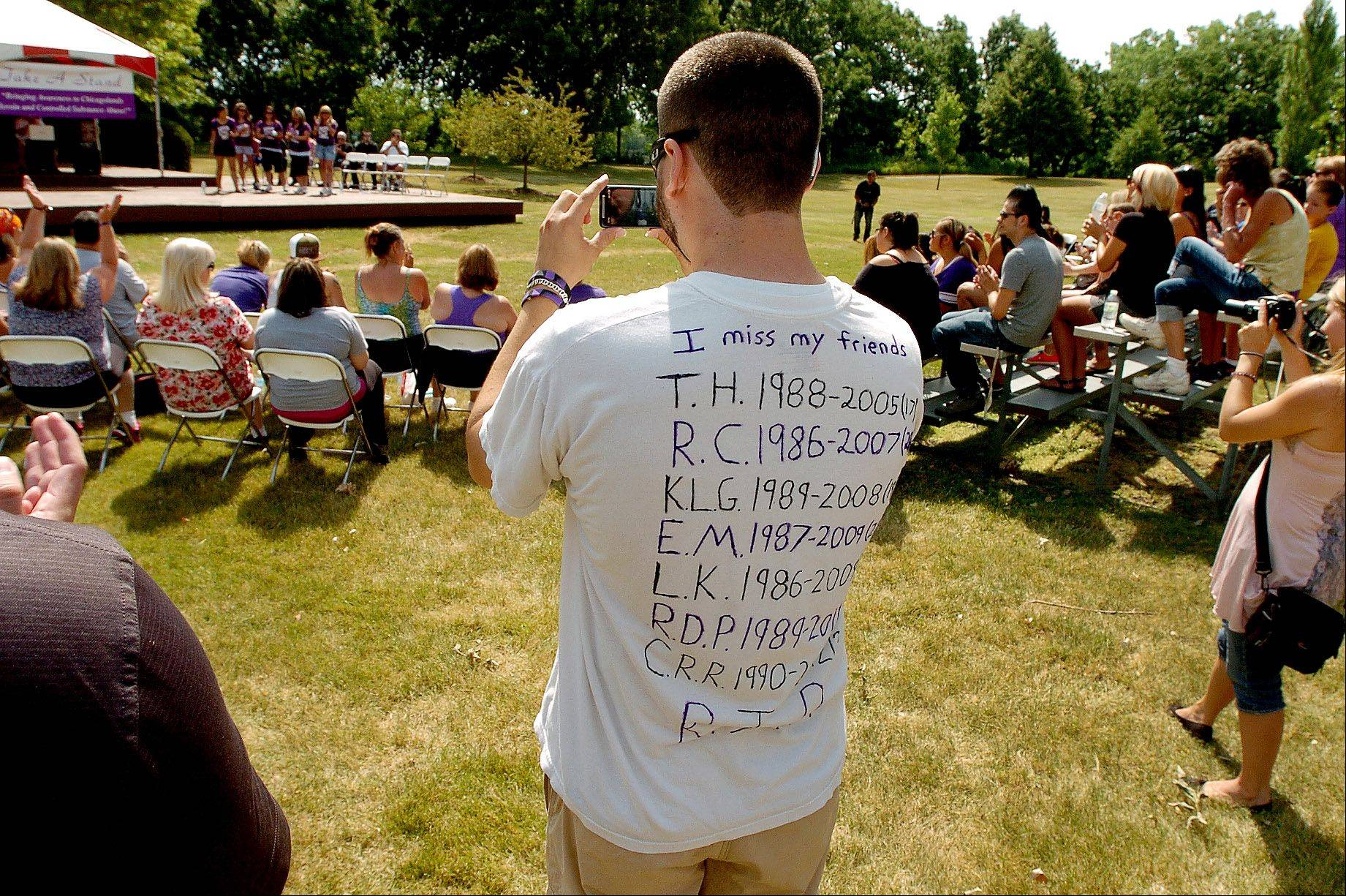 Trevor Marks of Lake Zurich wears a T-shirt with the names of seven friends that have died from heroin-related deaths.