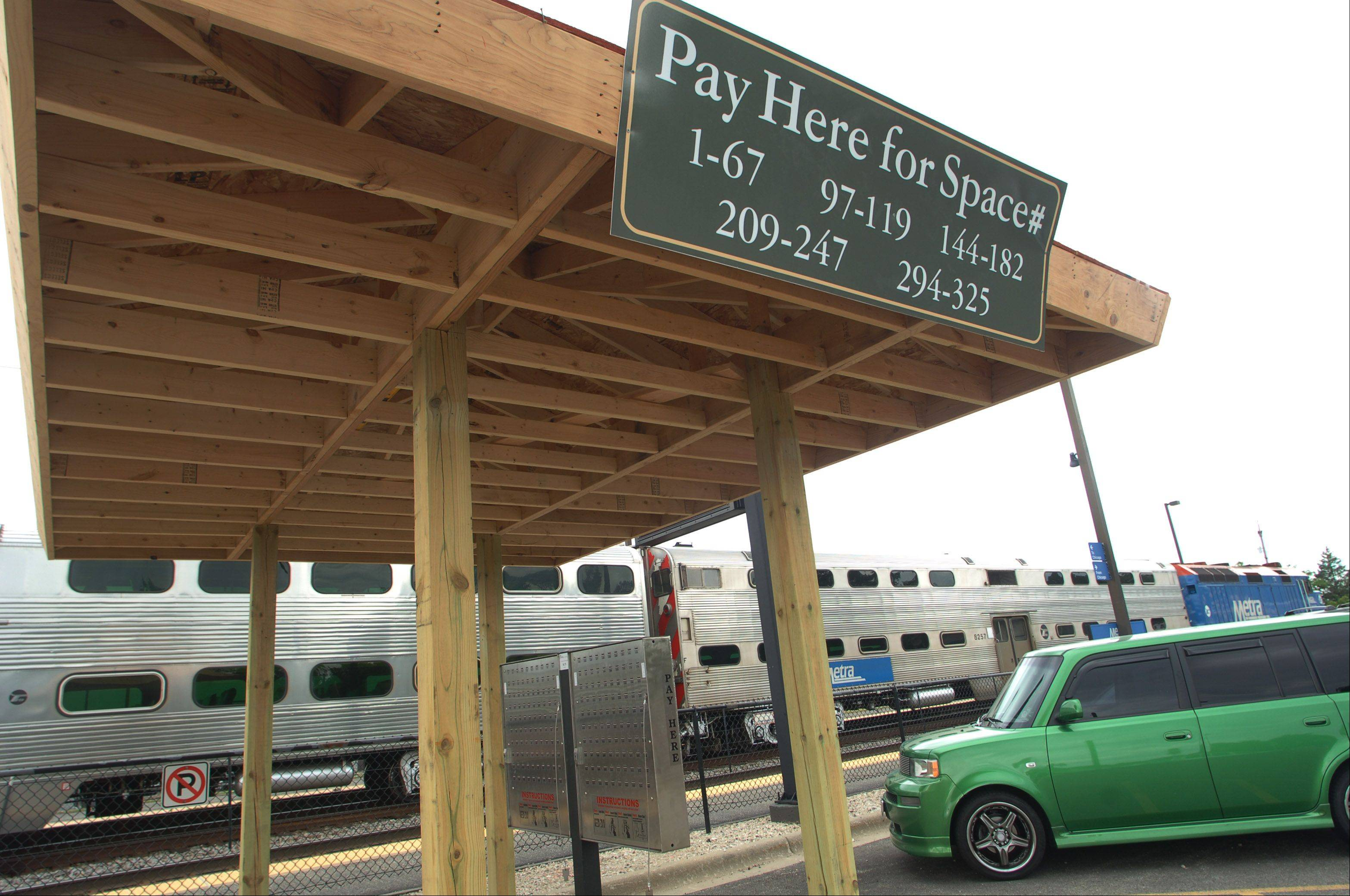 New shelters have been built to cover the new pay boxes at the Grayslake Lake Street Metra station.