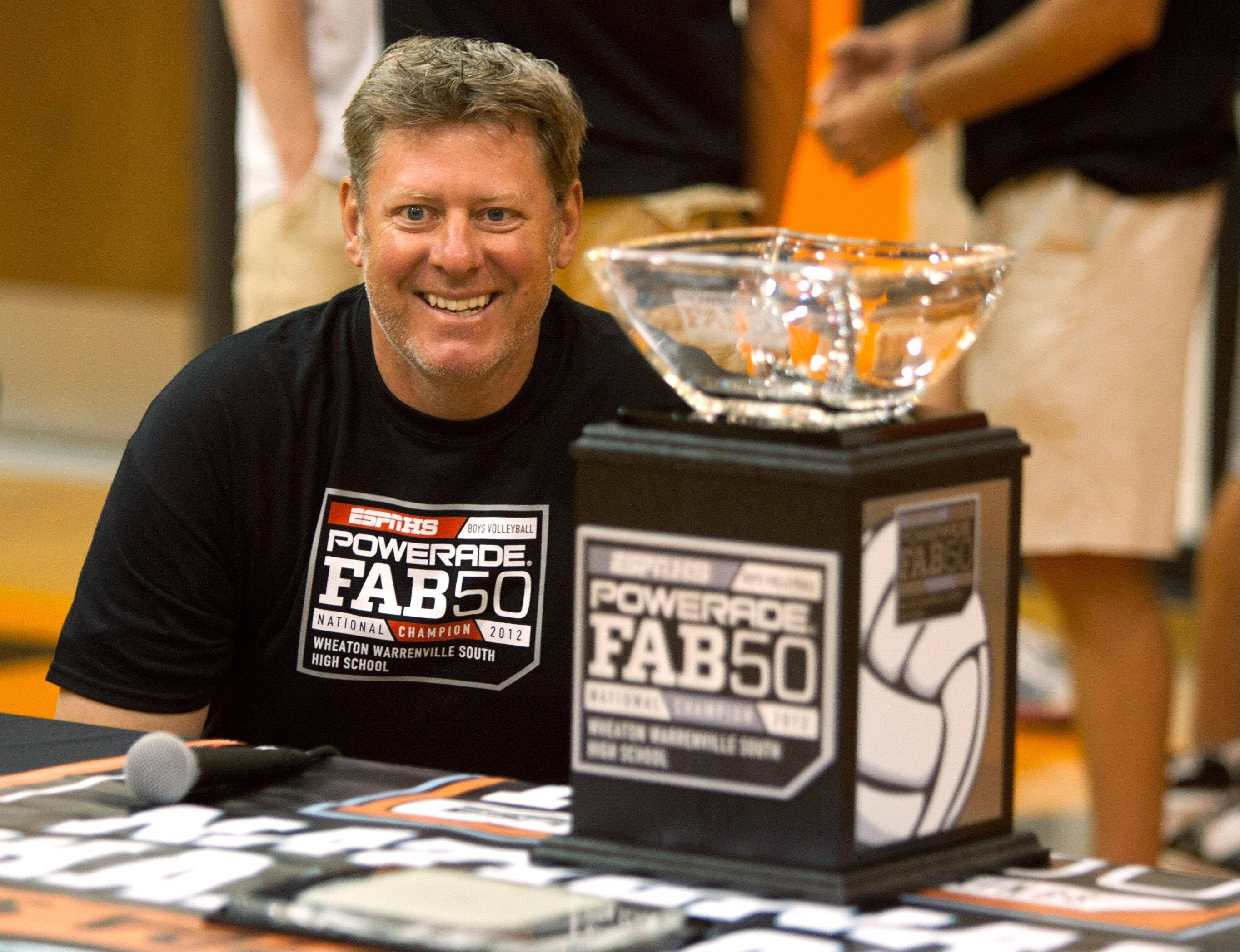 Head coach Bill Schreier is all smiles during an assembly Friday honoring the Wheaton Warrenville South boys volleyball team with a national championship.