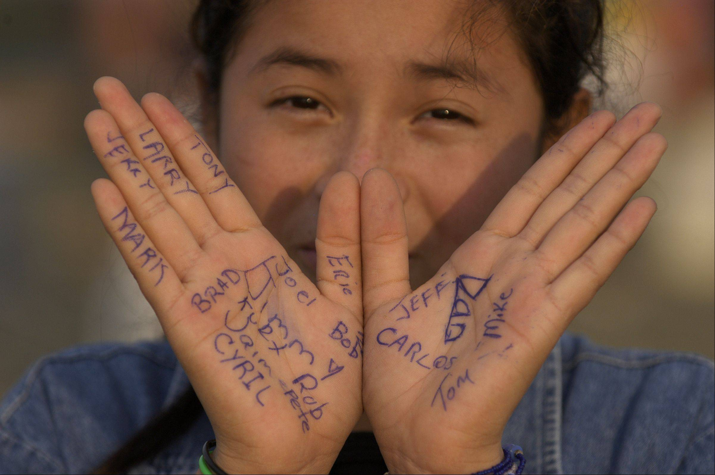 A young girl in Acuna, Mexico holds up her hands filled with the names of the men who built her family a new house. Jeff Knox was one of them.