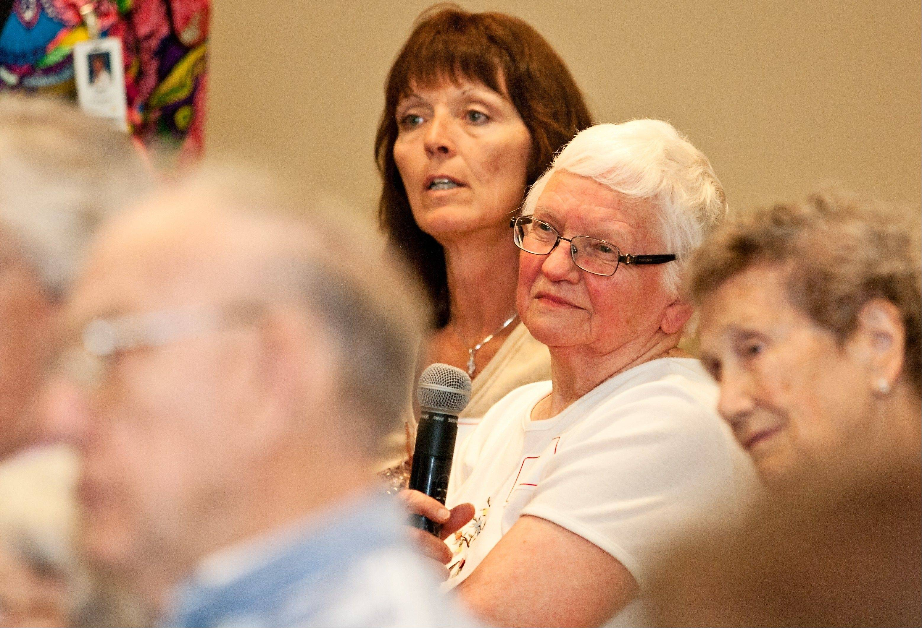 Florence Penne, 84, of Lisle, listens while Gary Piattoni appraises her item.