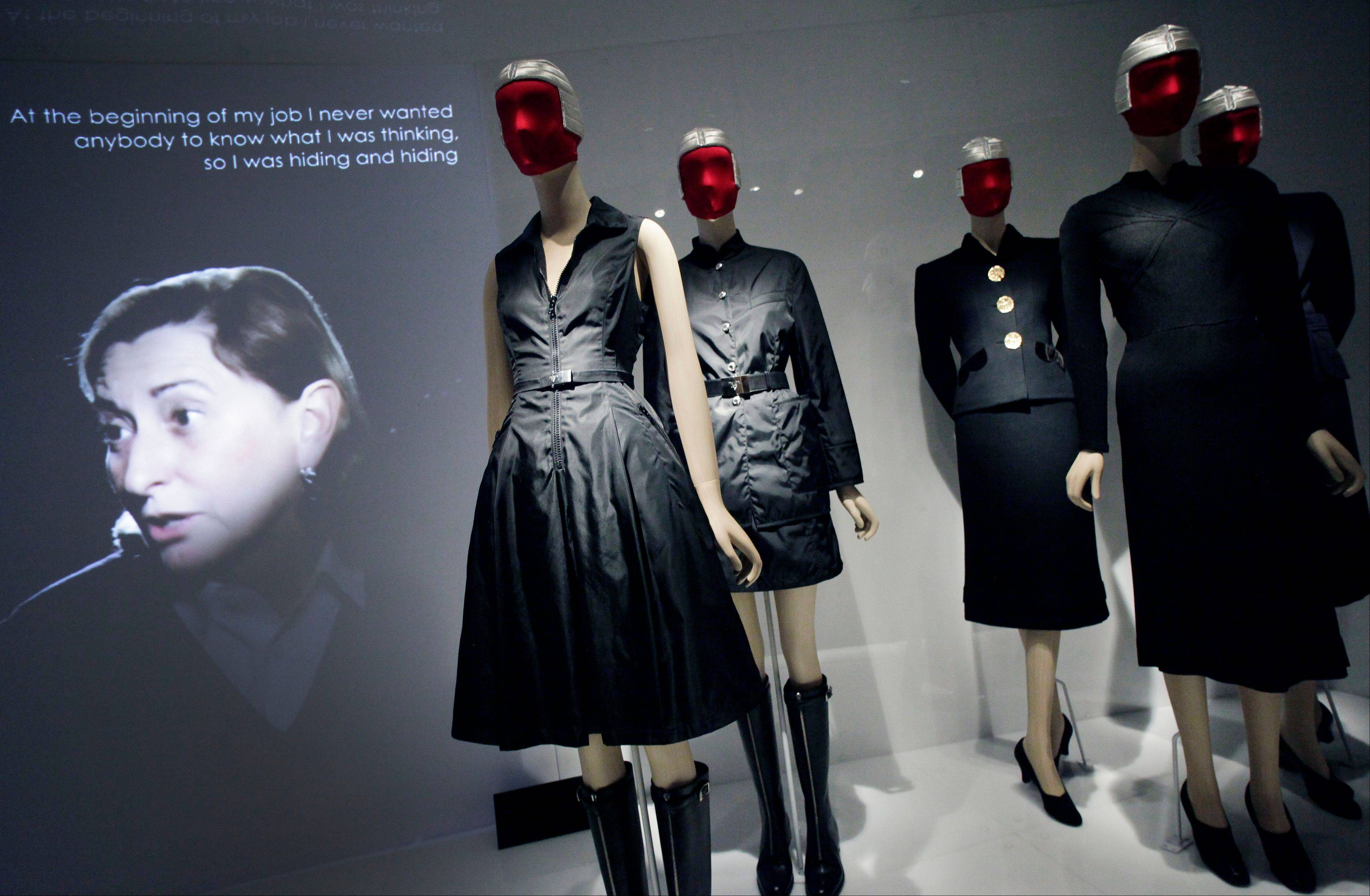 "Miuccia Prada, left, speaking in a video about her two fashions, center, and those of Elsa Schiaparelli, right, at an exhibit at the Metropolitan Museum of Art in New York. The show ""Schiaparelli and Prada, Impossible Conversations,"" continues through Aug. 19."