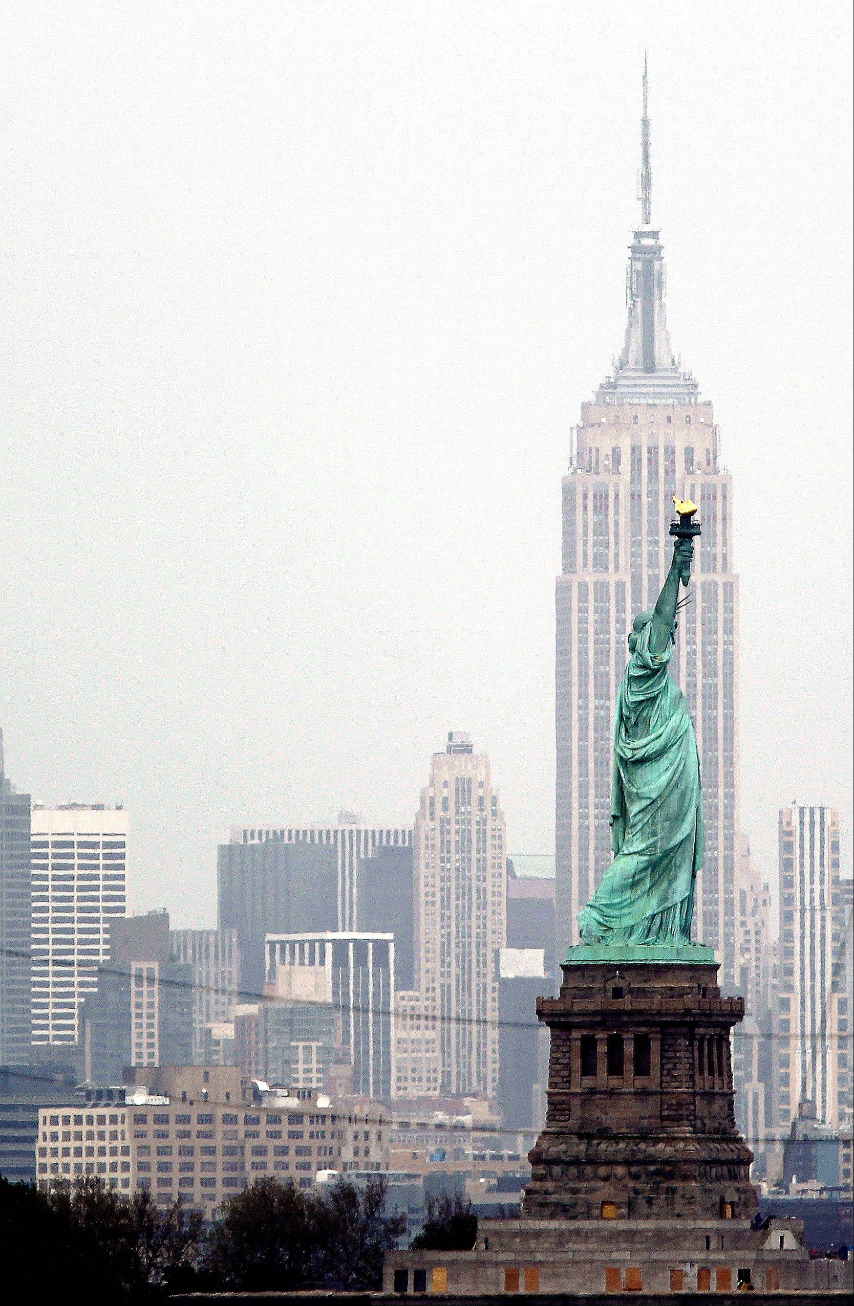 A view of New York's Empire State Building behind the Statue of Liberty from Bayonne, N.J.