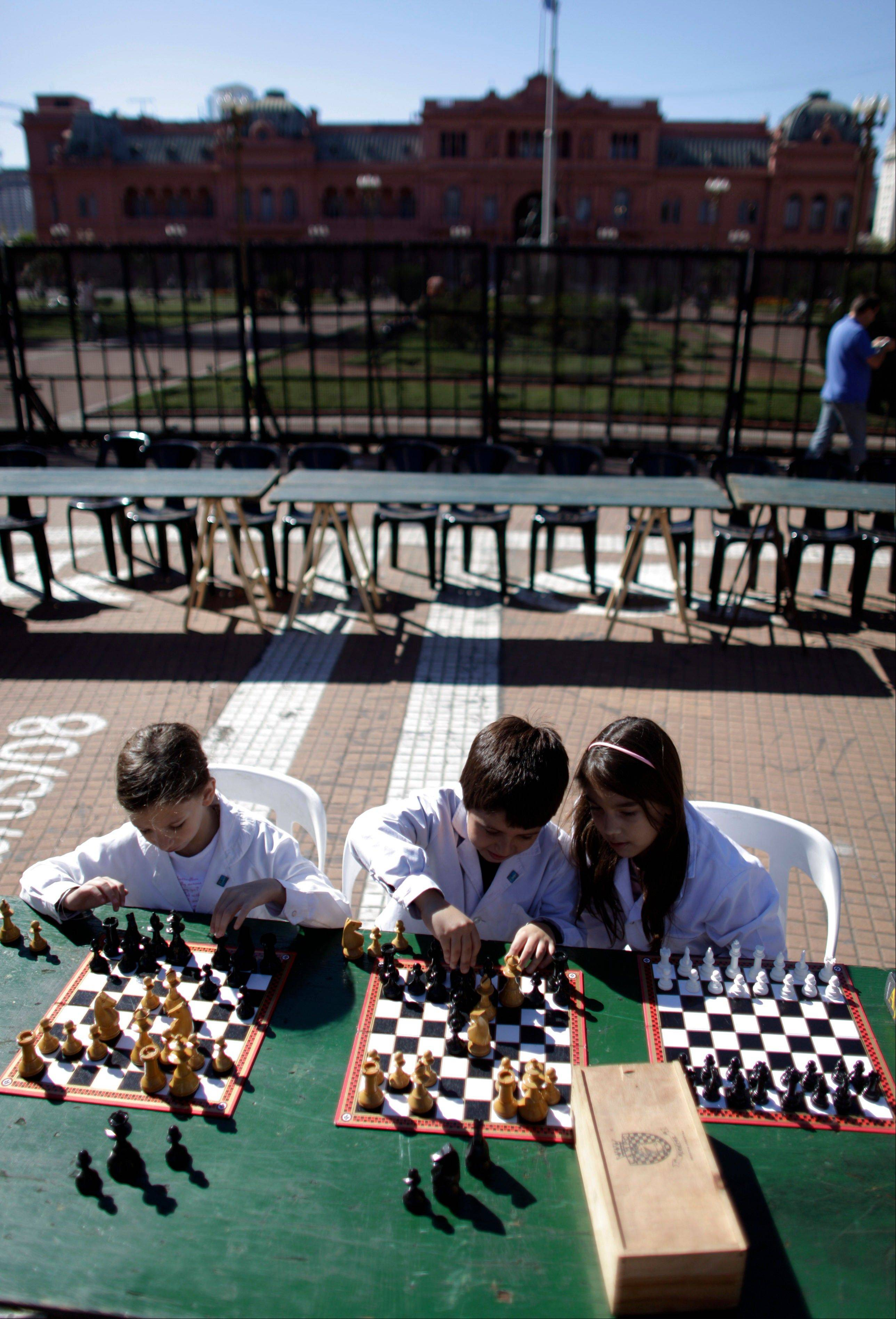 Students play chess at the Plaza de Mayo during the Argentina's School Chess Day in Buenos Aires.