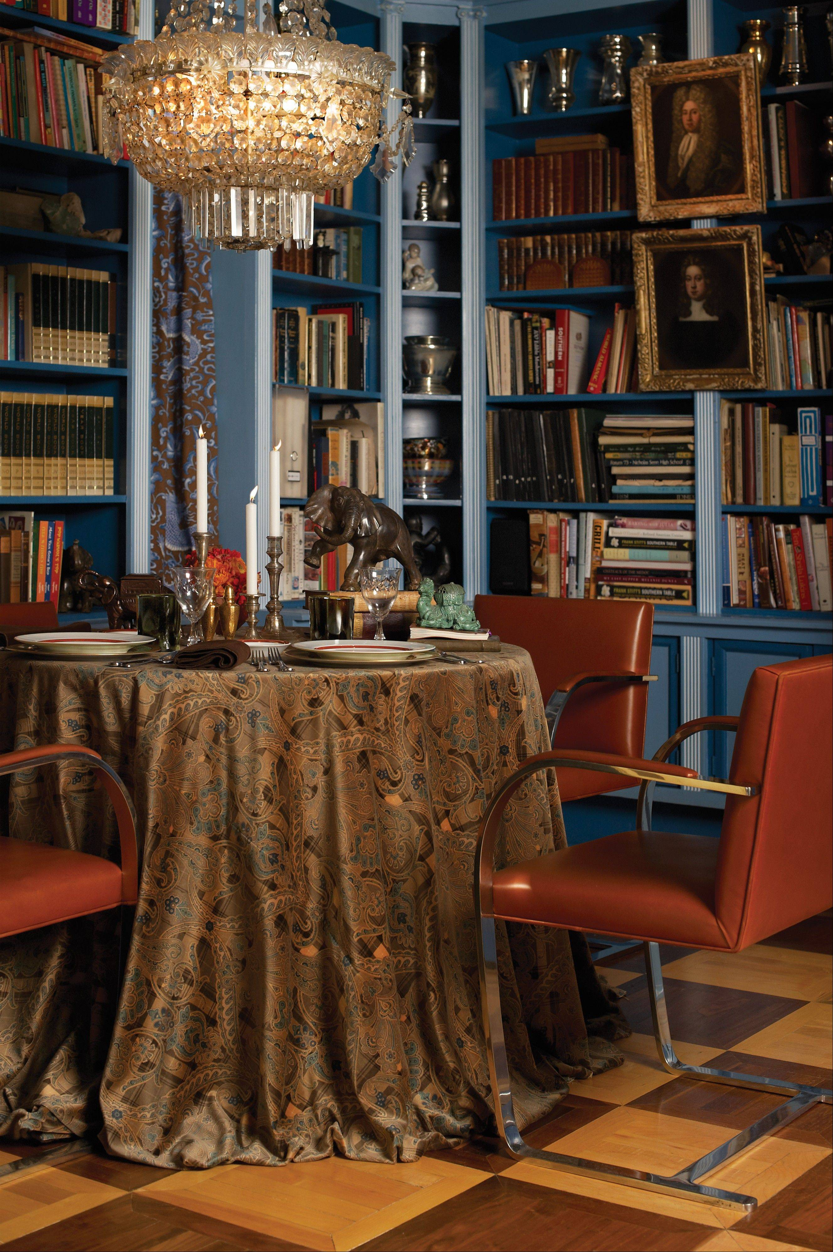 Ah, book club in Peter Rosenbaum's Chicago library. The paisley mixed with a tartan is named Highland Fling. Like most of the fabrics, it is by Scalamandre.