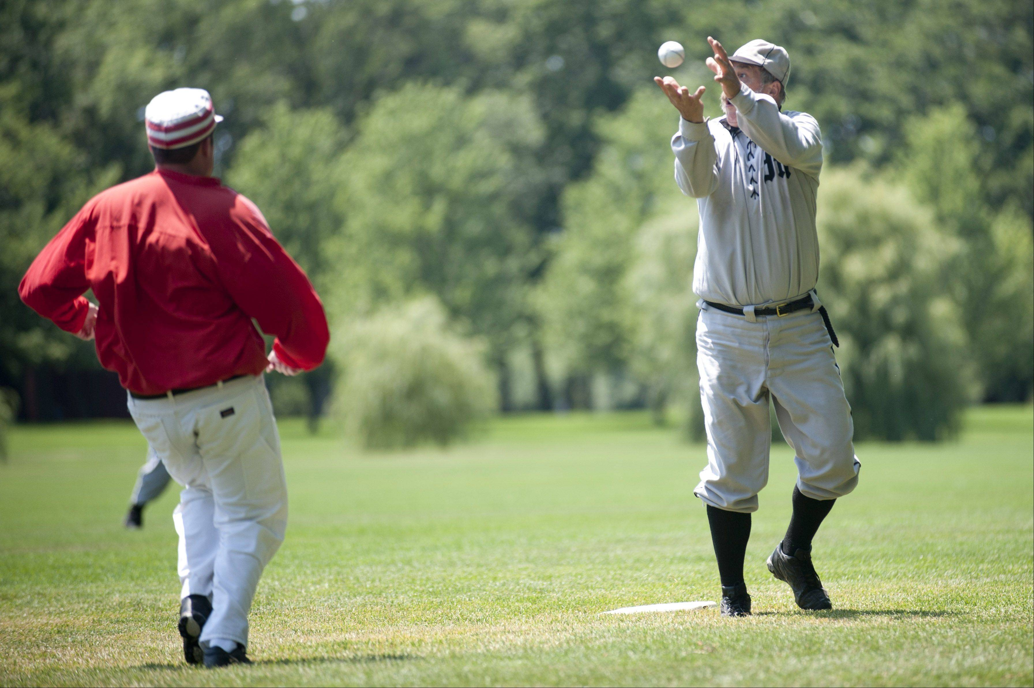 "Mike ""Dead Pull"" Collins, of the Milwaukee Grays, makes a play at first base during a vintage ""base ball"" game at Cantigny Park in Wheaton on Sunday. The event featured teams playing the sport under the very different set of rules as they existed in 1858."