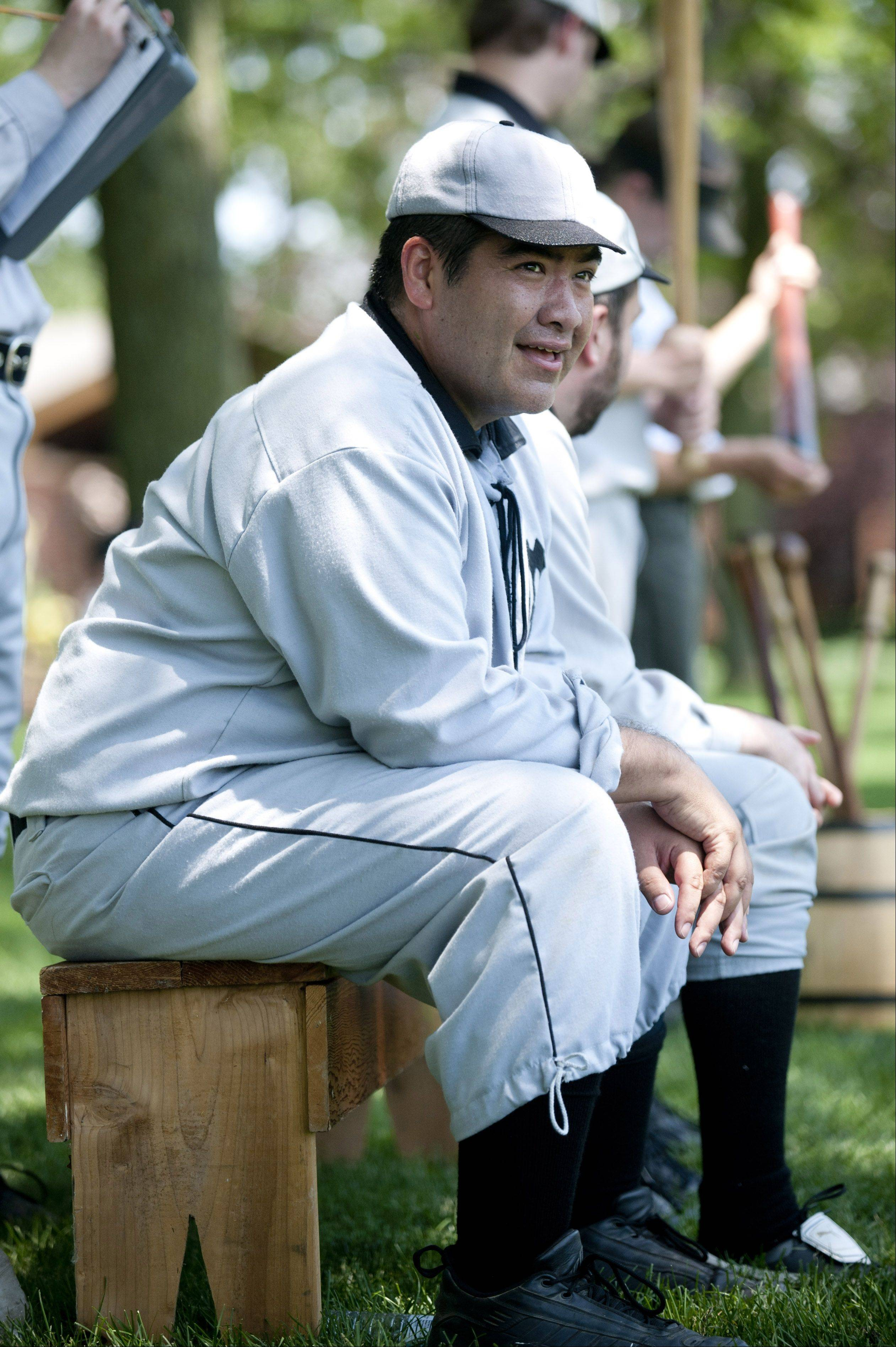 "Enrique ""El Toro"" Rodriquez, of the Milwaukee Grays, enjoys playing in a vintage ""base ball"" game at Cantigny Park in Wheaton on Sunday. The event featured teams playing the sport under rules of the game as they existed in 1858."
