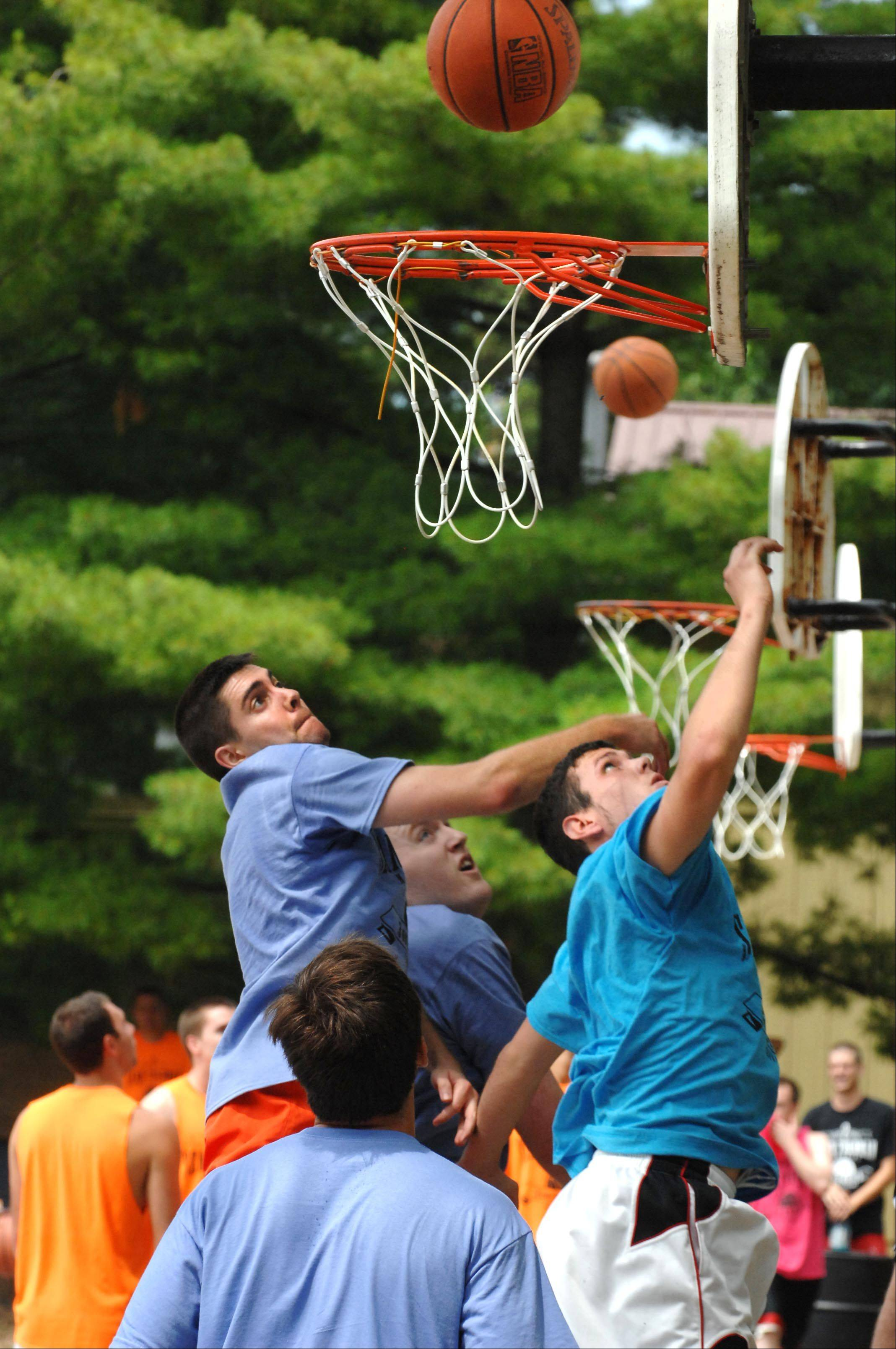 Players scramble for a rebound Sunday at the second annual Sean Toedman Memorial 3-on-3 Basketball Tournament at Lions Park in East Dundee. Teams competed and raised money to benefit St. Jude Children's Research Hospital in Memphis. Sean Toedman was a 12-year-old boy who died of a brain tumor.
