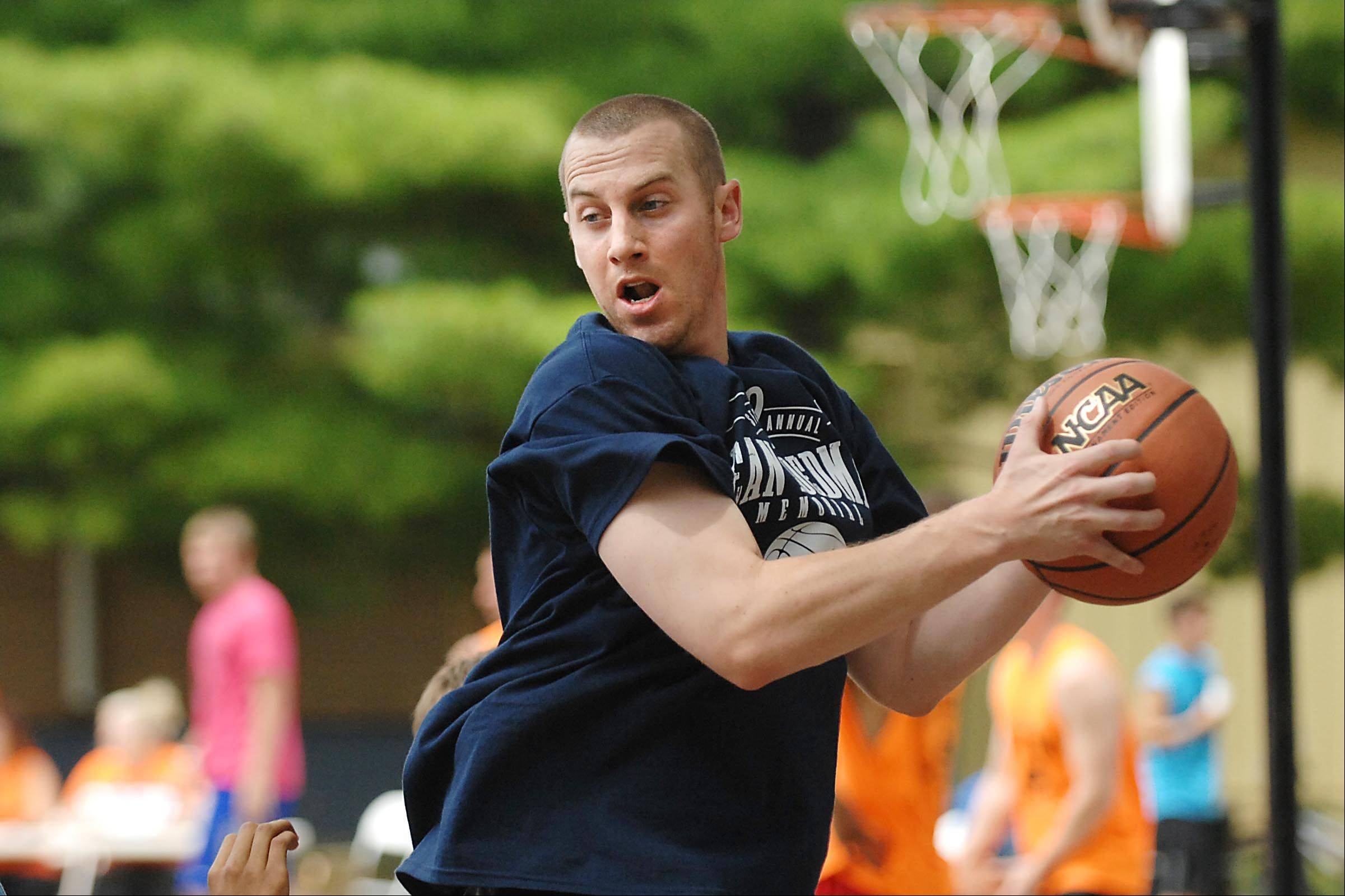 Jim Moran, a former Algonquin Jacobs High School basketball standout, competes with two of his brothers at the second annual Sean Toedman Memorial 3-on-3 Basketball Tournament at Lions Park in East Dundee. Teams competed and raised money Sunday to benefit St. Jude Children's Research Hospital in Memphis.