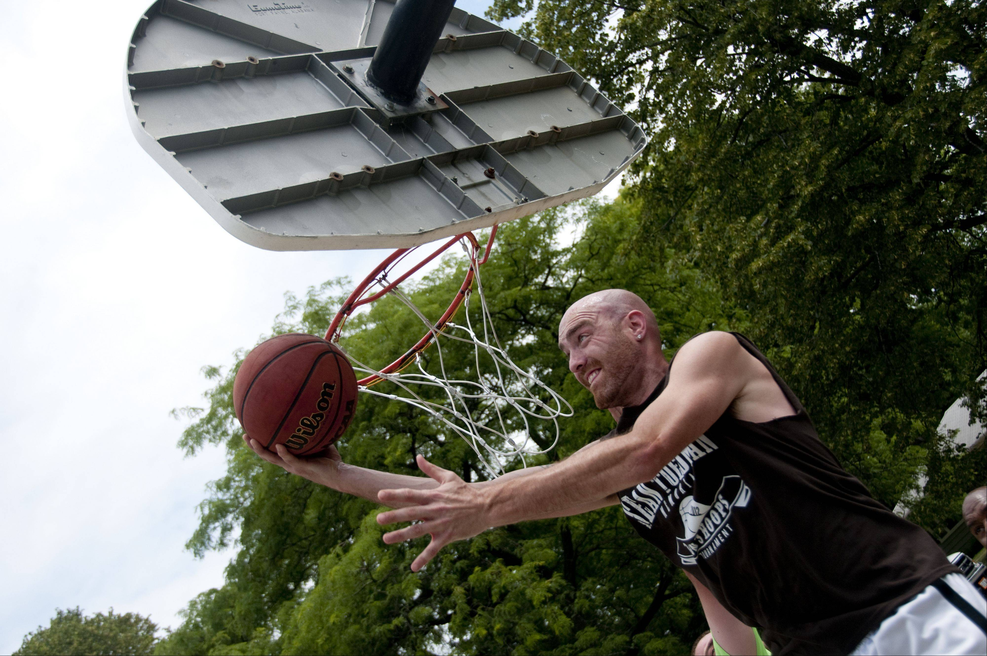 Mike McKibben, a Lake in the Hills resident, goes for a layup during the second annual Sean Toedman Memorial 3-on-3 Basketball Tournament Sunday at Lions Park in East Dundee. Proceeds from the event went to St. Jude's Children's Research Hospital.
