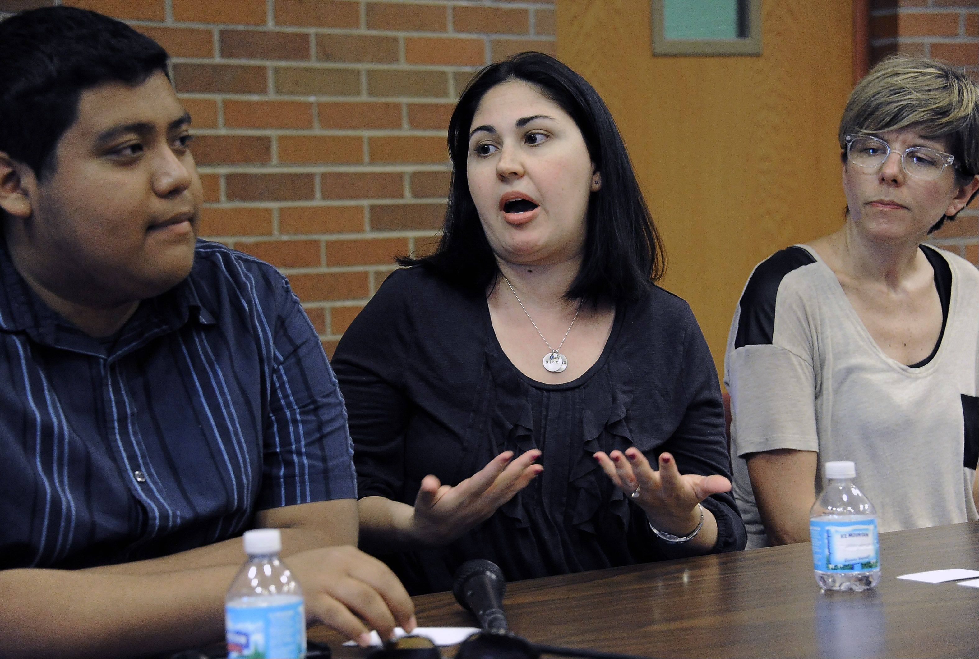 "Dawn Ferencz, a Elk Grove High School English teacher and member of the Gay-Straight Alliance. talks to recent Palatine High School graduate Gilberto Vaquero, Jr. and others at the ""Out in the Suburbs"" panel discussion group last week."