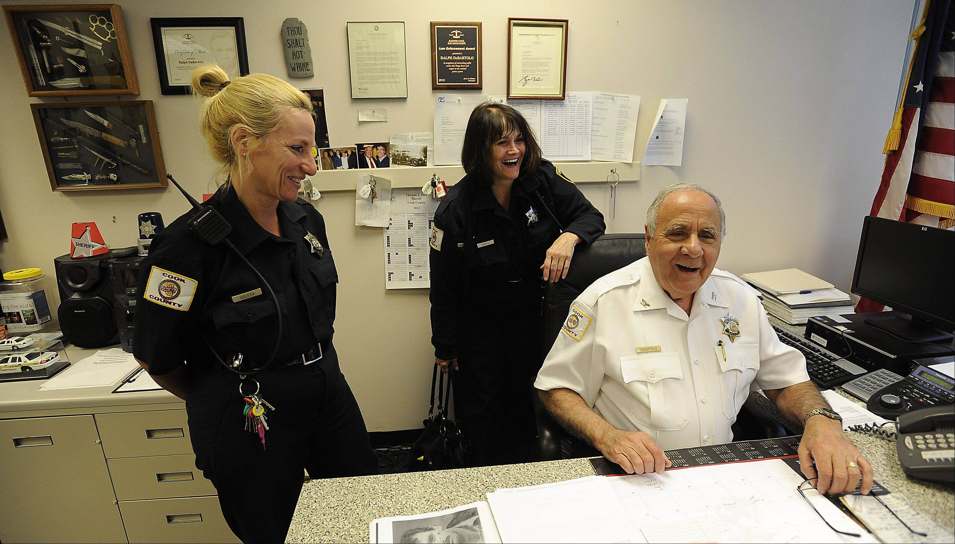"Not only does Chief Ralph DeBartolo have an ""open-door policy"" with the 72 deputies and staff he oversees at the Rolling Meadows courthouse, he means it. Deputies Dianna Shlifka and Jeanne Raines, right, praise the chief for his fairness and friendly way."
