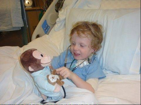 Quinn Loeger, at age 4, was treated at Children's Memorial Hospital in Chicago nearly two years ago after a difficult and rare type of heart surgery.