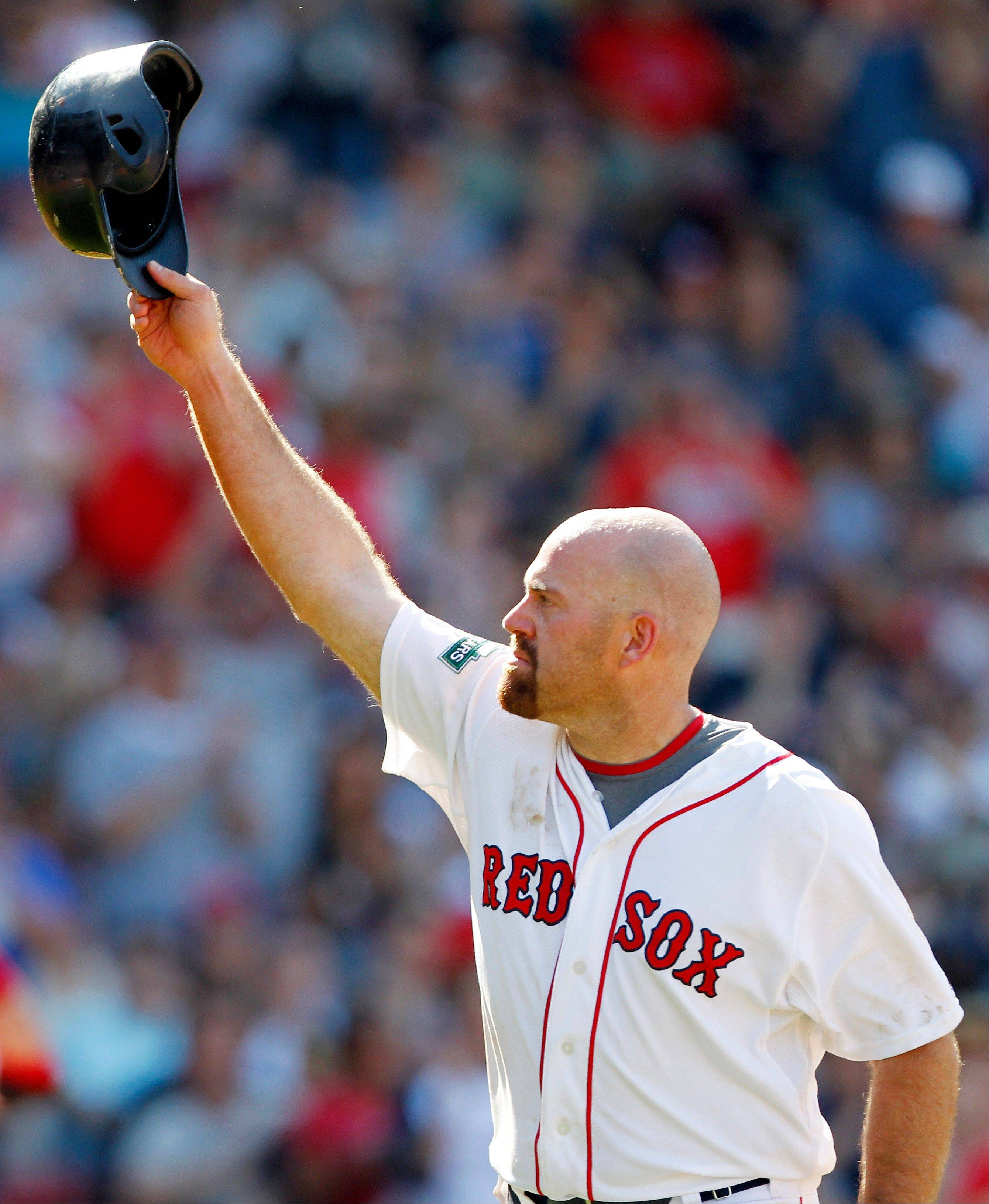 Kevin Youkilis tips his helmet to Red Sox fans as he comes off the field after hitting a triple and being replaced by a pinch runner in the seventh inning Sunday, his last day in Boston after being traded to the White Sox.