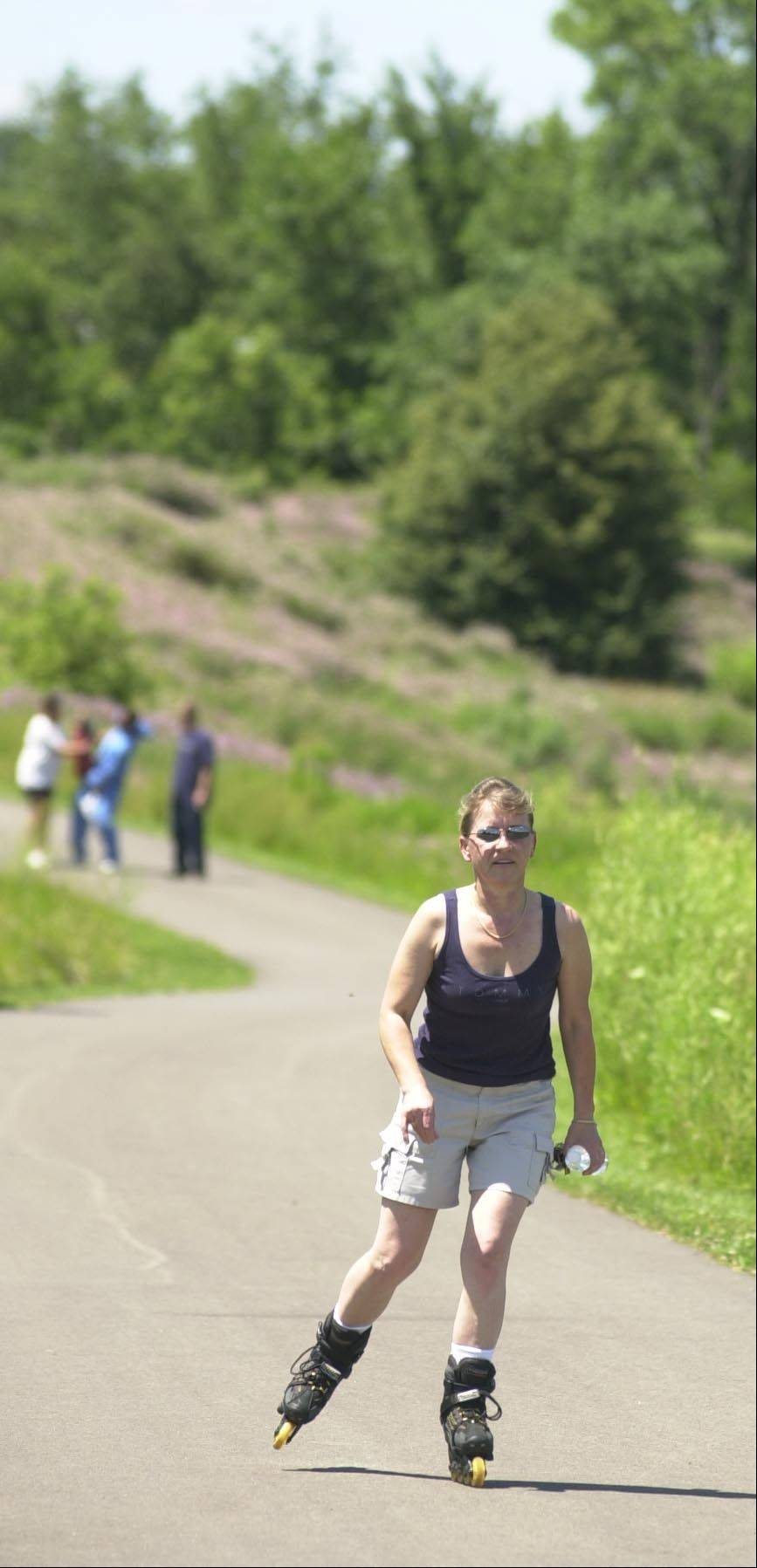 Inline skaters and hikers can share public trails without incident by following trail etiquette.