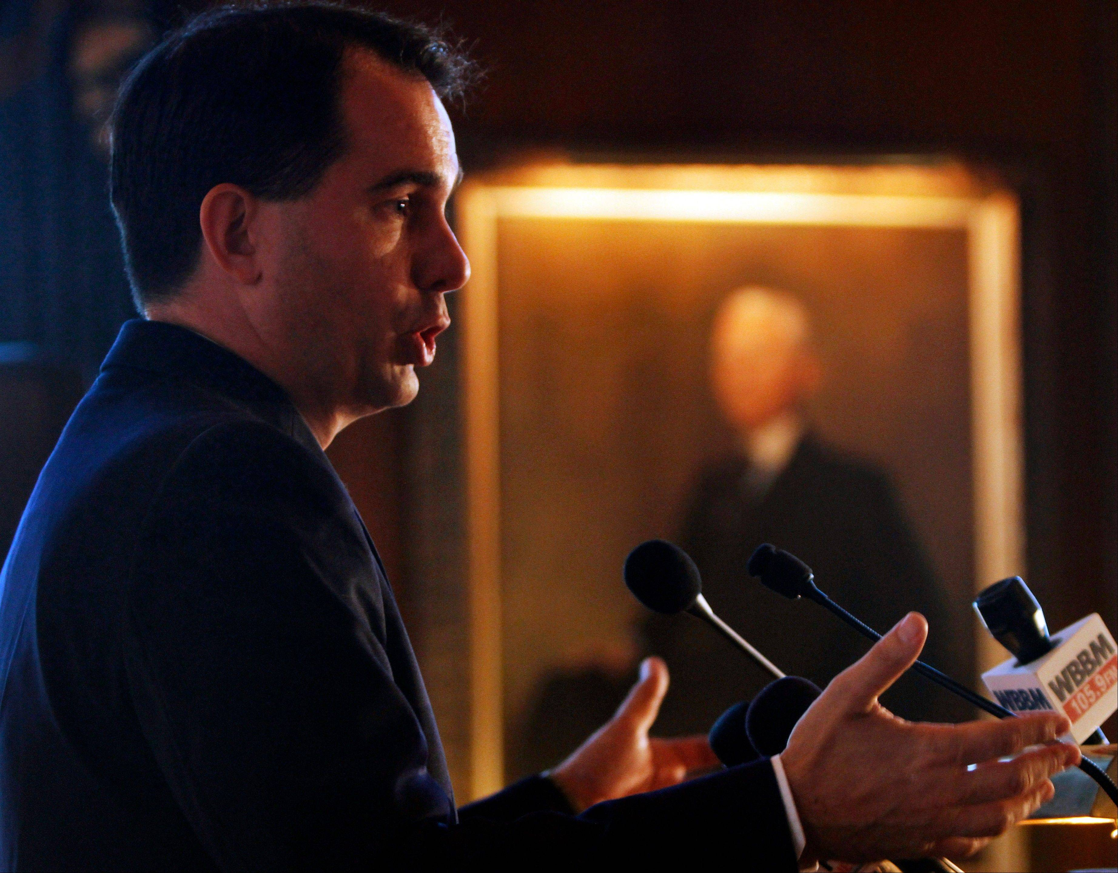 Wisconsin Gov. Scott Walker speaks at a news conference Monday after his address on pension reform and fiscal responsibility to the Commercial Club of Chicago.