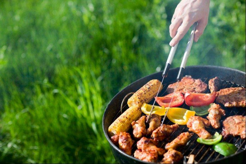 Grilling lean meats and vegetables are two ways to keep your cookouts healthy this summer.