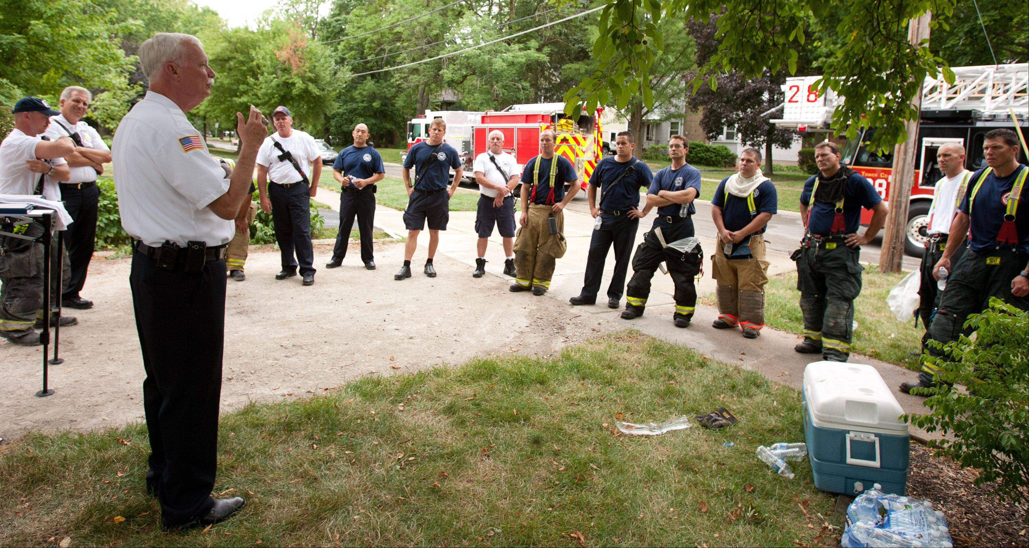 Wheaton Fire Chief Greg Berk, left, discusses a cooperative fire training exercise among the Carol Stream, West Chicago, Winfield and Wheaton fire departments.