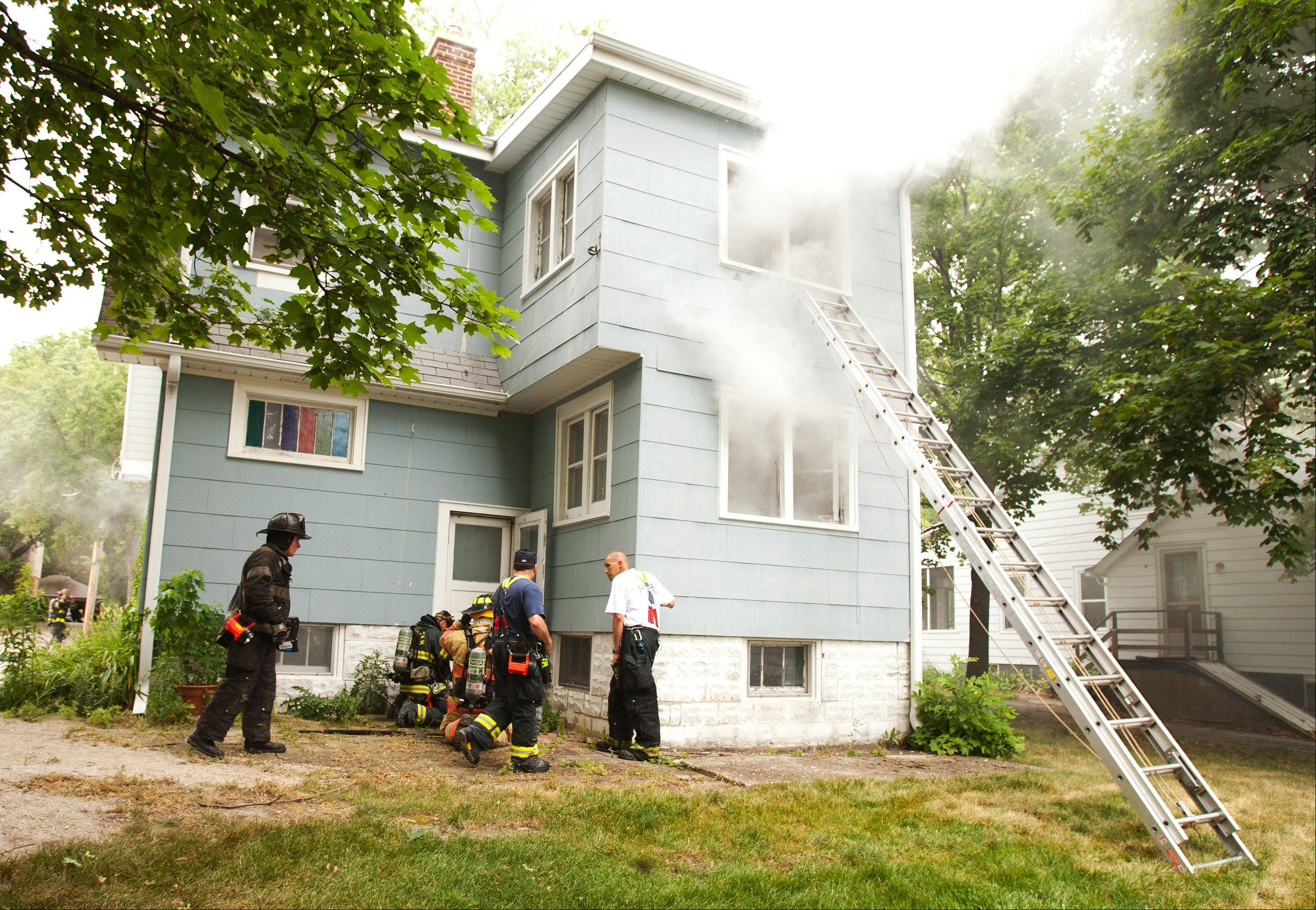 Smoke from a machine was pouring out of a vacant house in Wheaton for the training exercise.